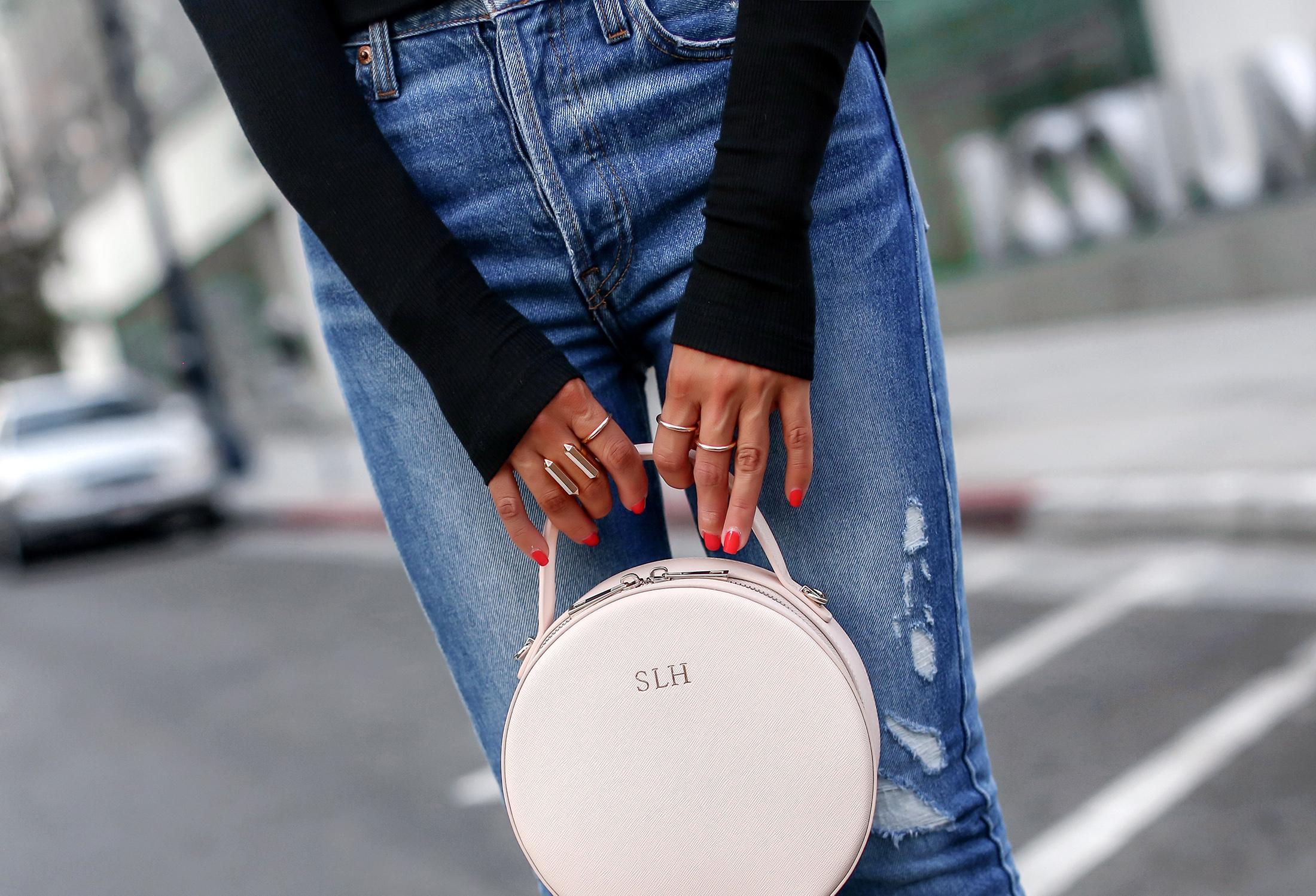 Woman Holding Circle Bag