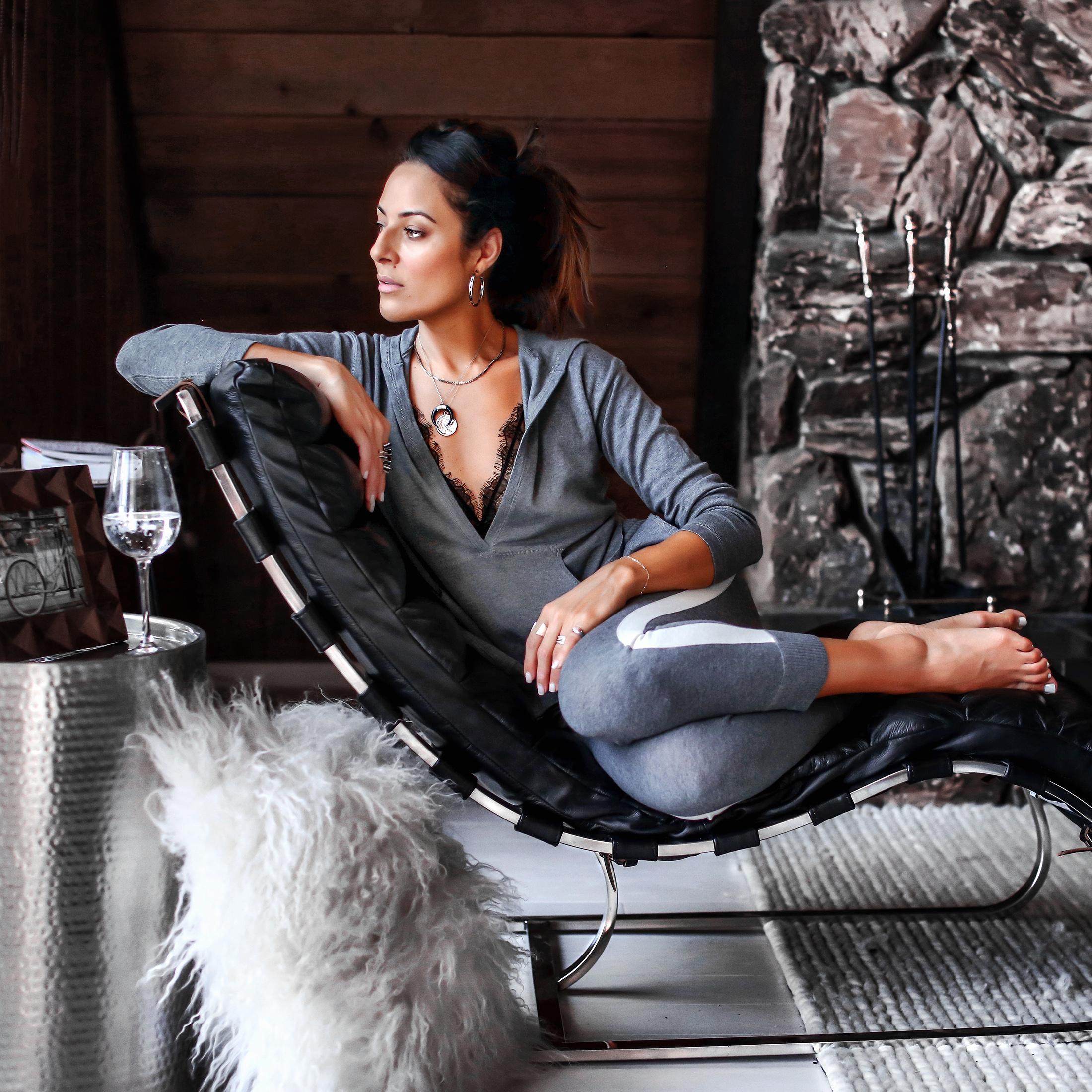 Brunette Woman Sitting In Modern Lounge