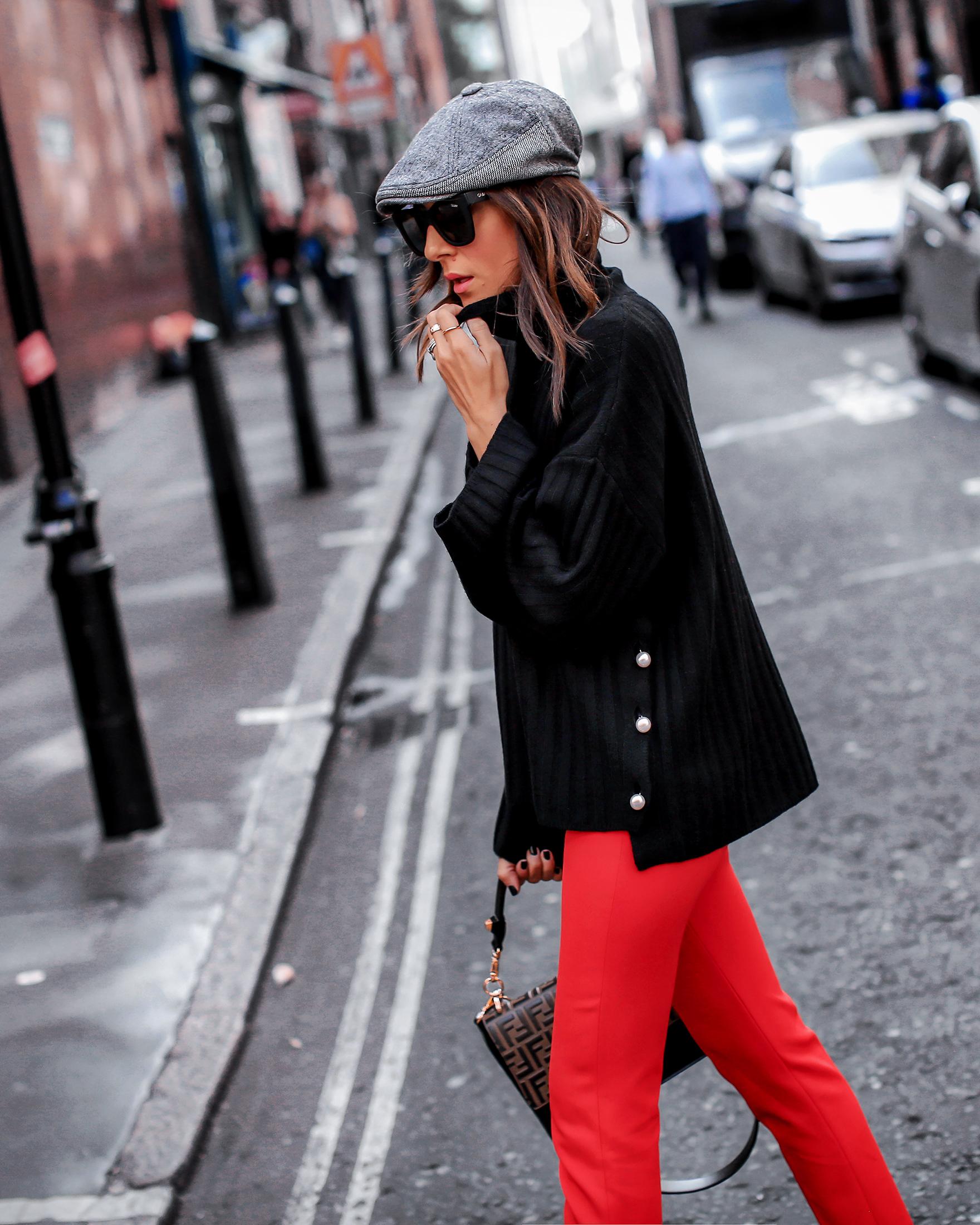 Brunette Woman In London Wearing Black Sweater