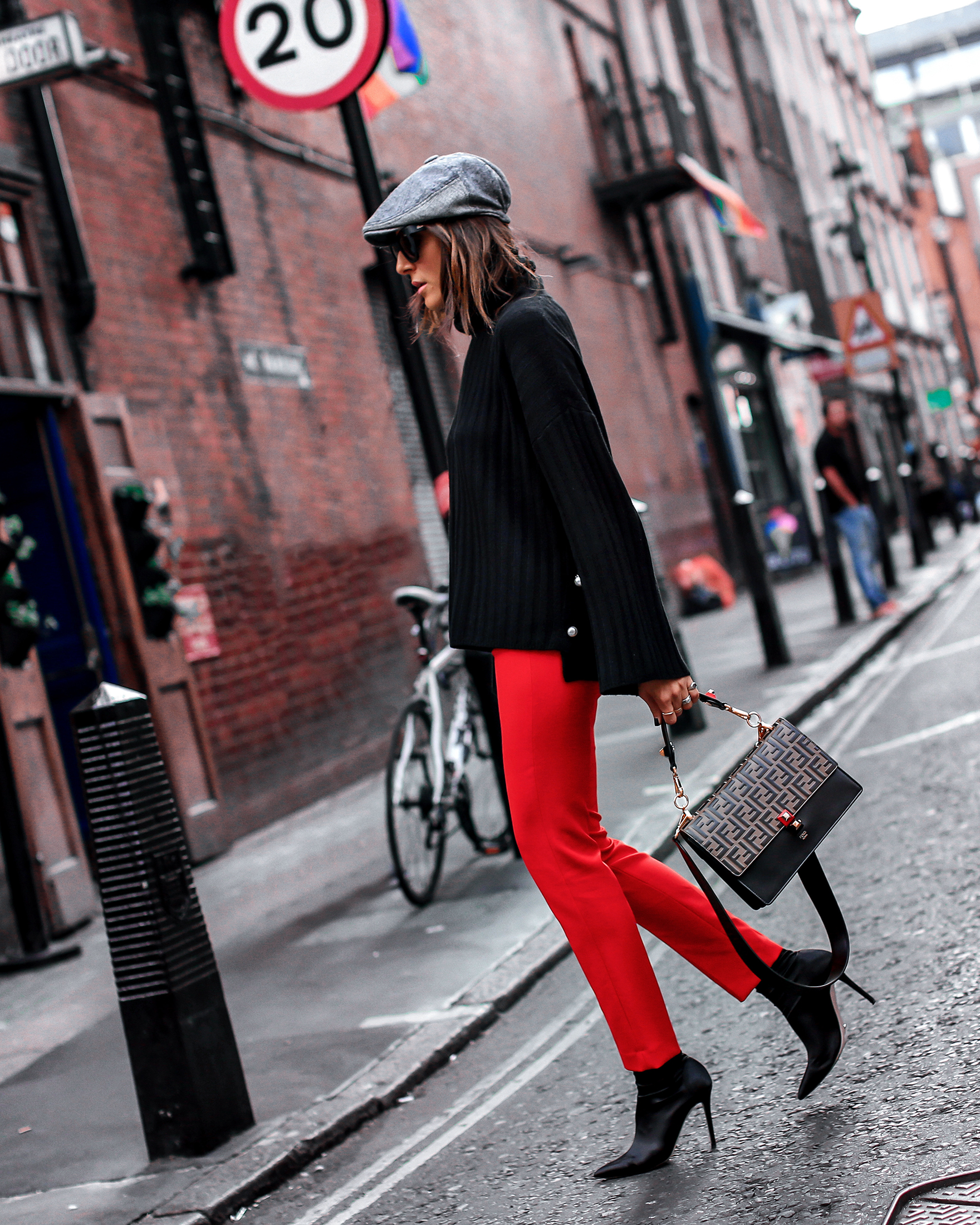 Brunette Woman In London Wearing Red Pants
