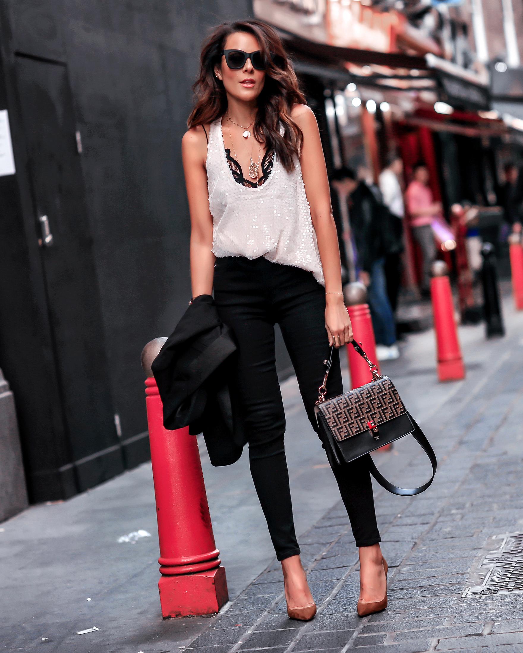 Brunette Woman In London Wearing VICIDOLLS Sequins Top Fendi Kan Bag