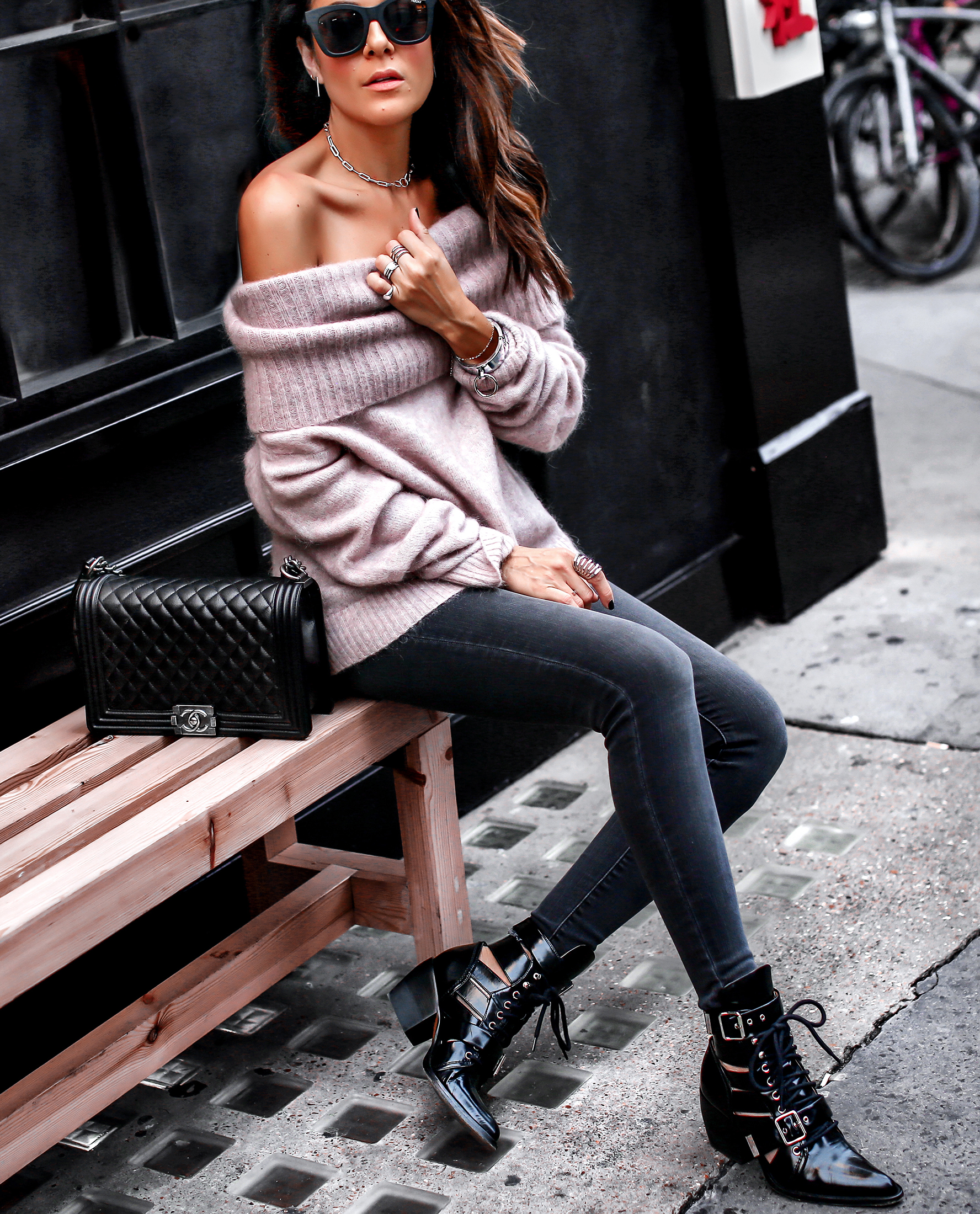 Brunette Woman In London Wearing Sweater and Western Boots