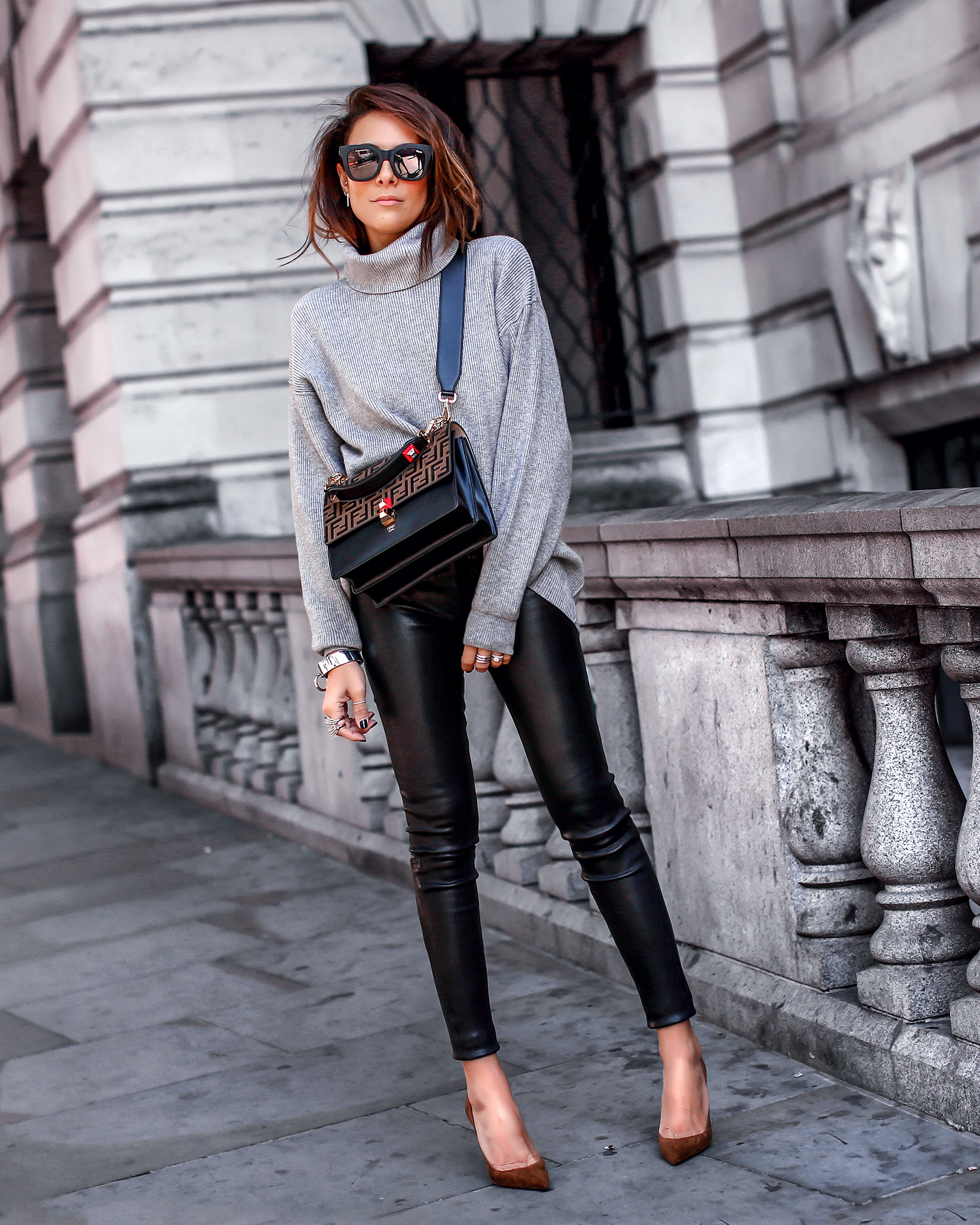 Brunette Woman In London Wearing Leather Pants and Free People Sweater Fendi Kan Bag