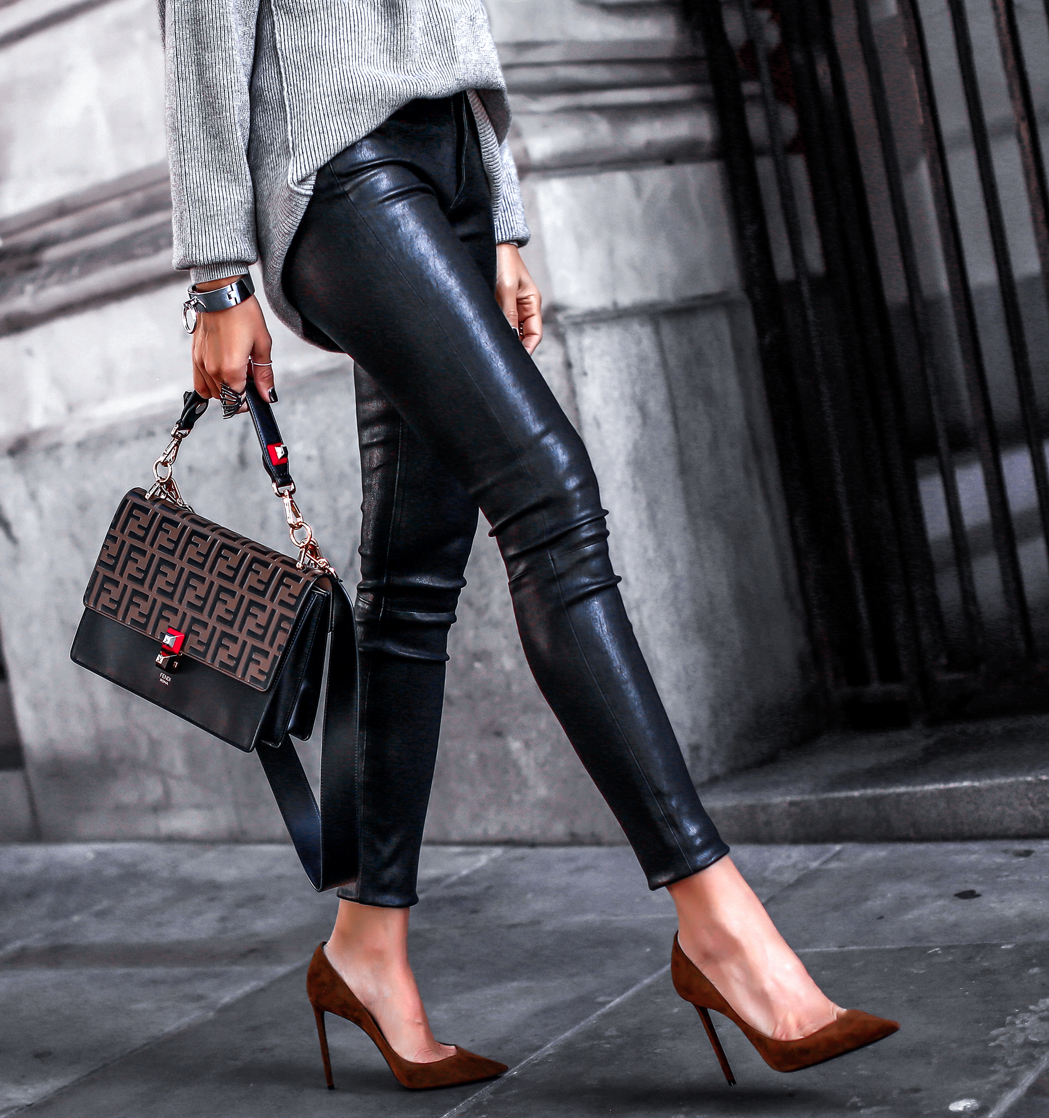 Woman Wearing Leather Pants and Free People Sweater Fendi Kan Bag