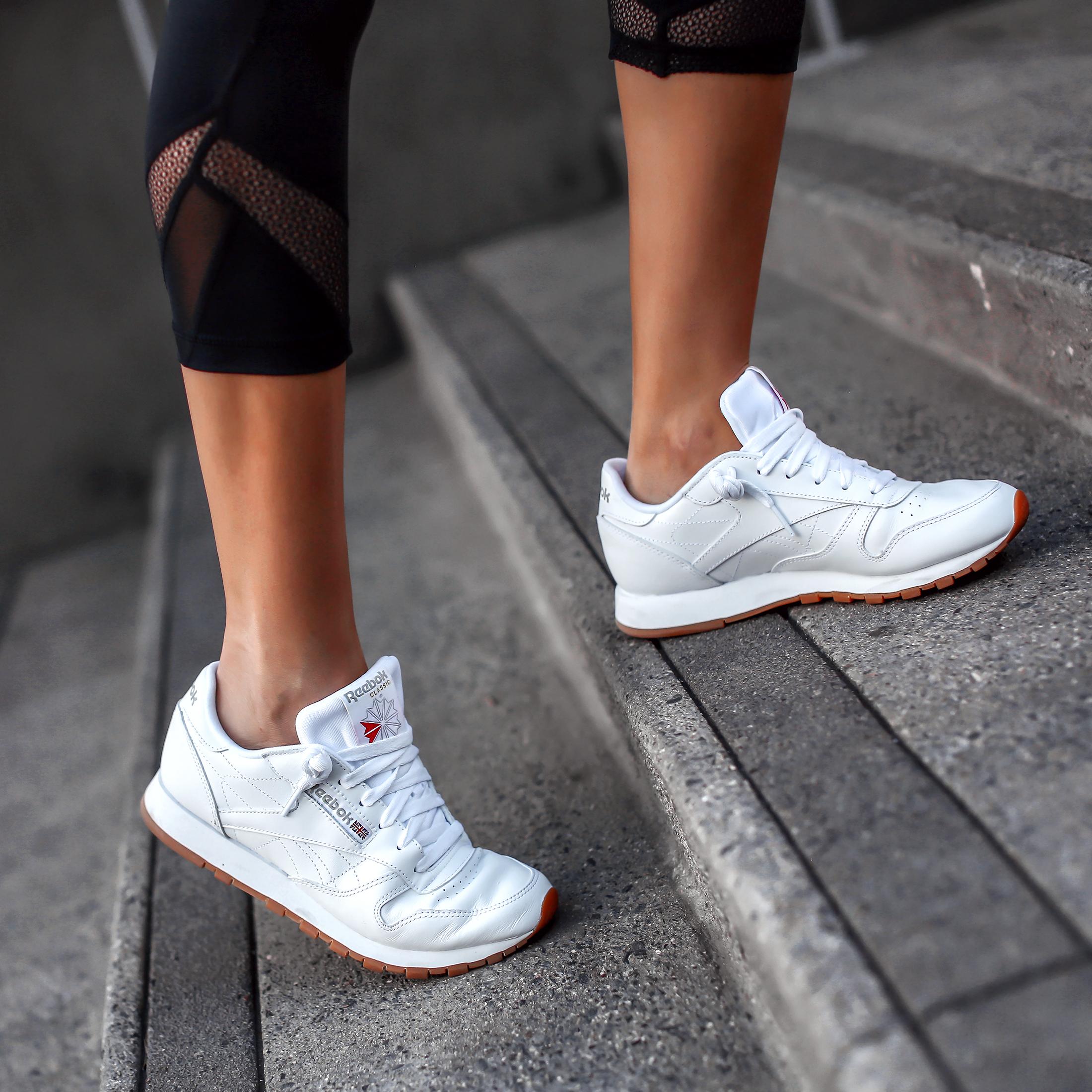 Woman Walking in Reebok Classic Sneakers