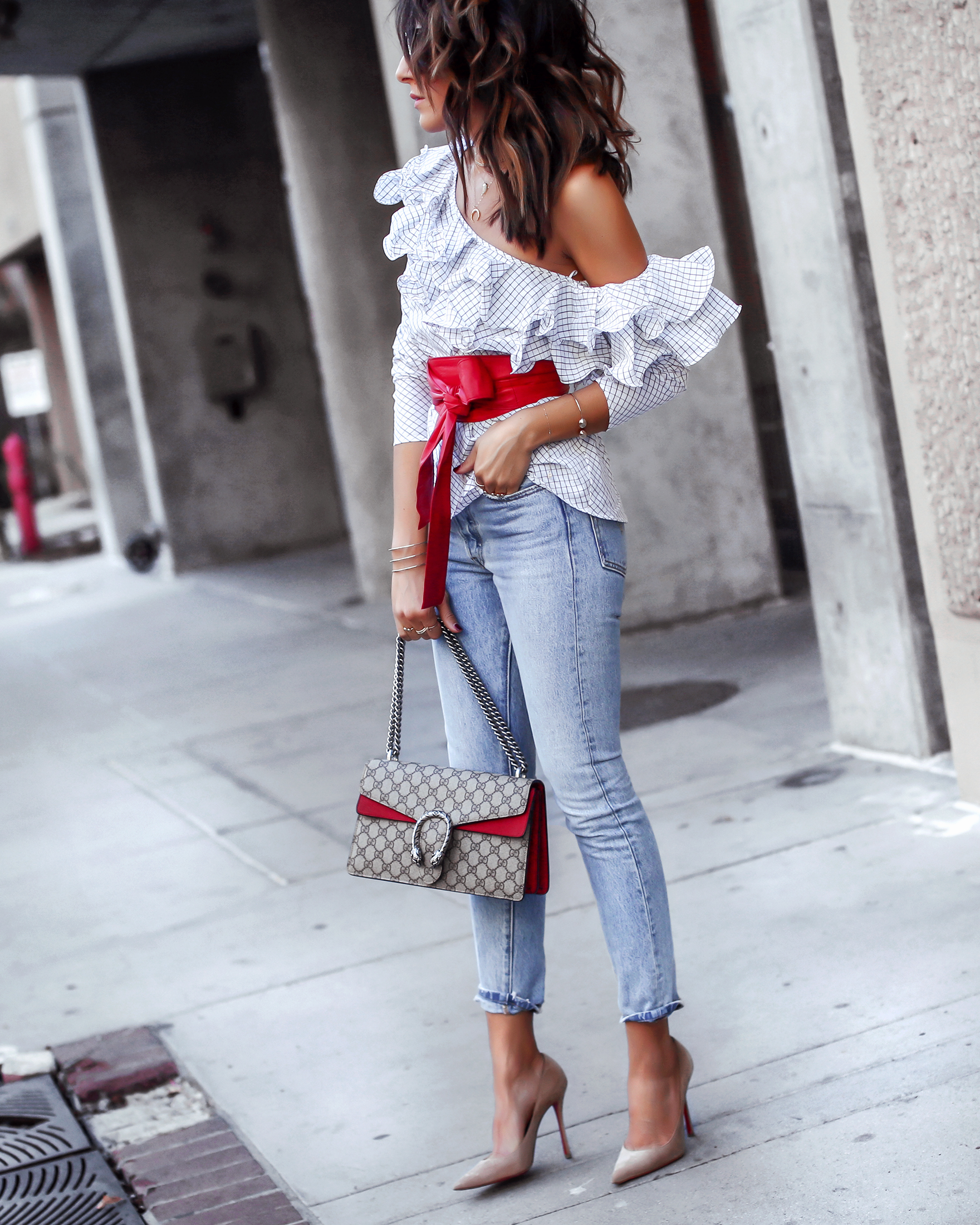 Brunette Woman in Levis and One Shoulder Top