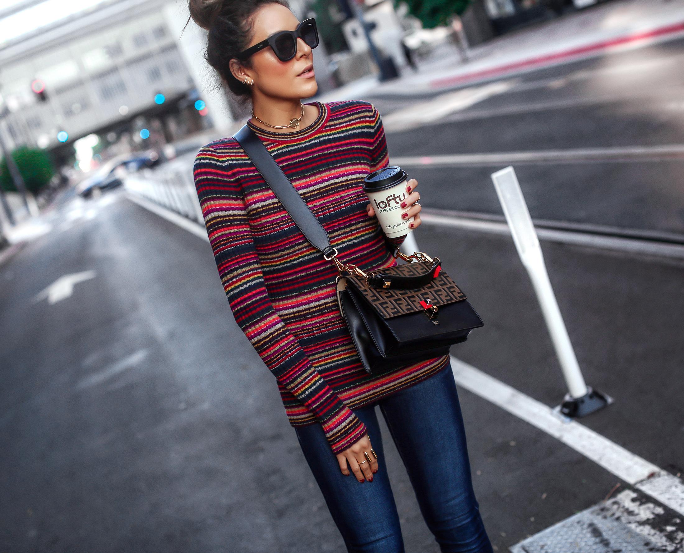 Brunette Woman Wearing Striped Knit Fendi Kan Bag