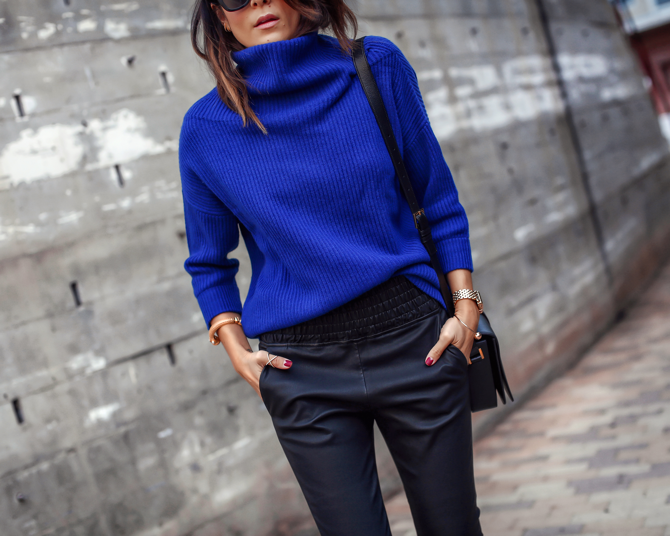 Brunette Woman Wearing Cashmere Sweater Leather Pants