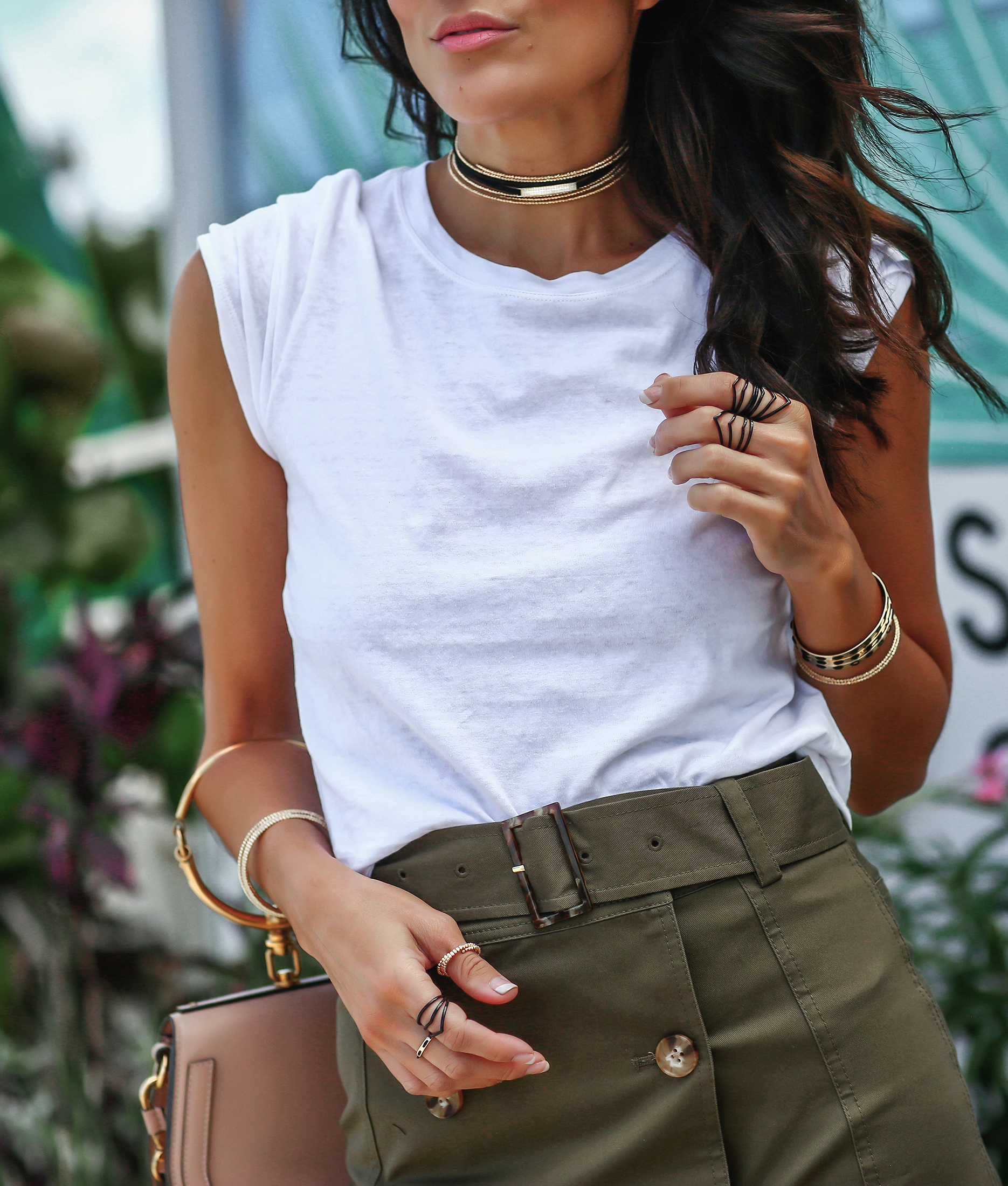 Detail Photo of Intermix Army Green Miniskirt and Arme Del Amour Jewelry
