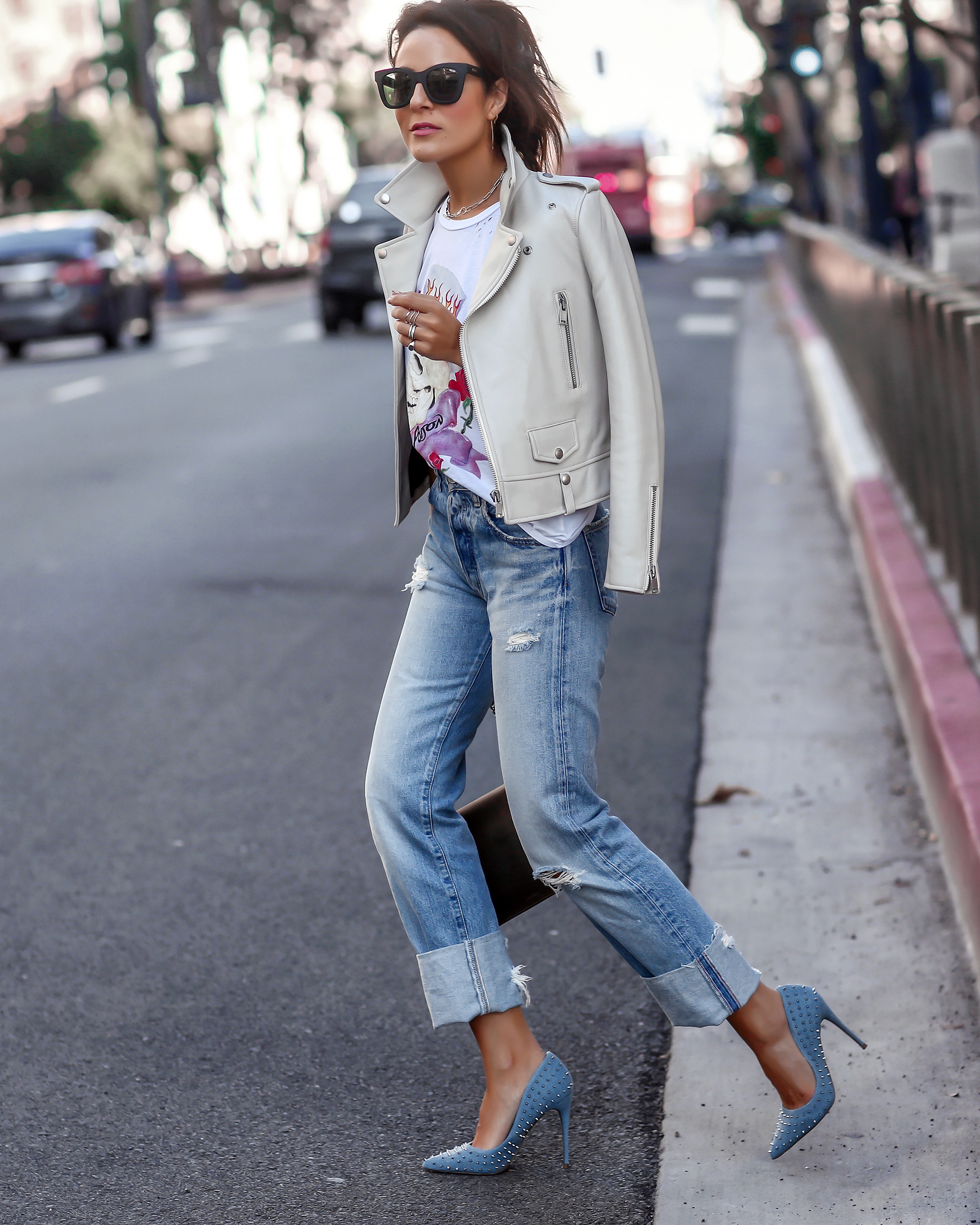 Brunette Woman Walking in Steve Madden Denim Studded Pumps Moussy Denim
