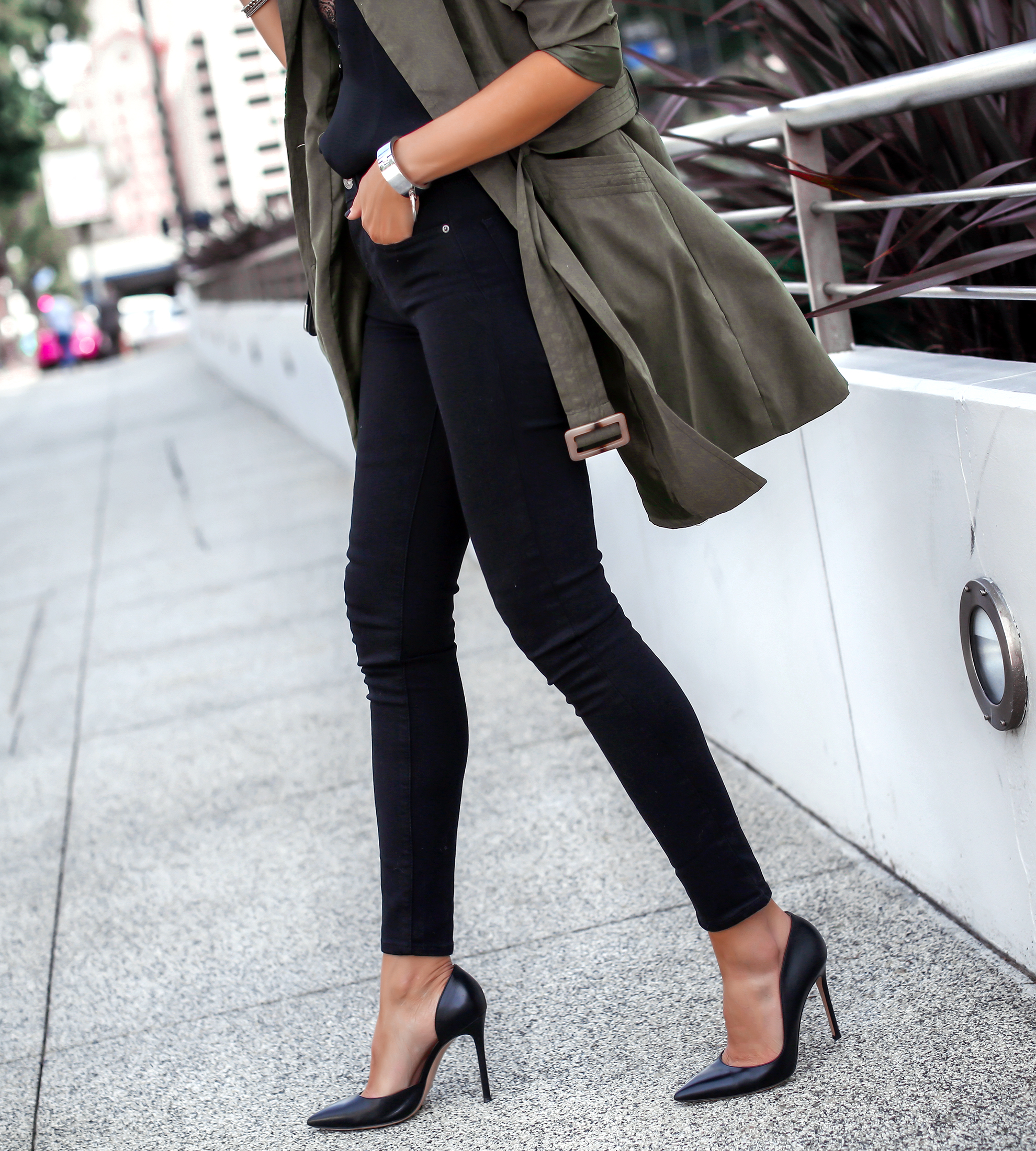 Woman Walking in Trench and Heels
