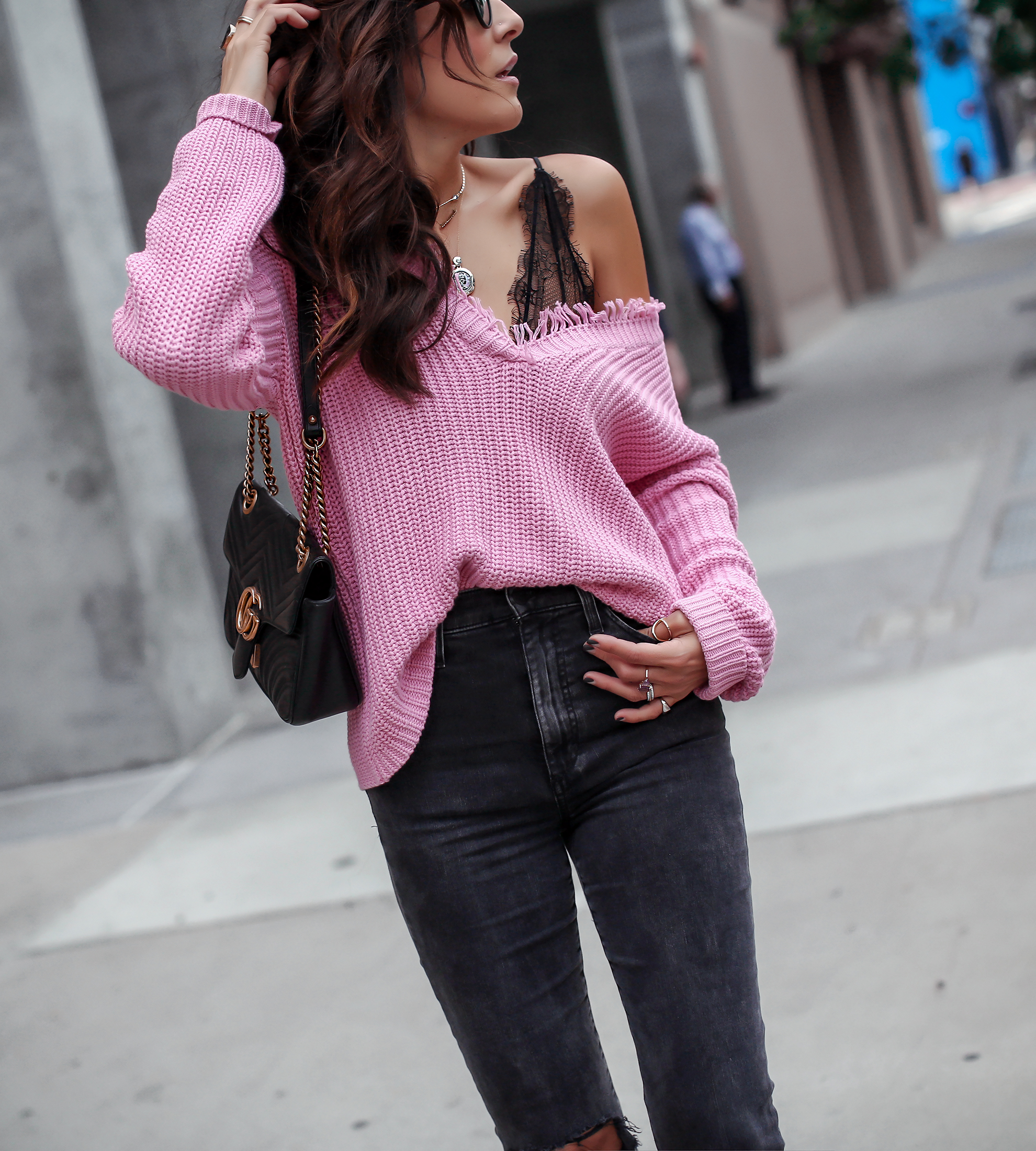 brunette woman in pastel pink sweater