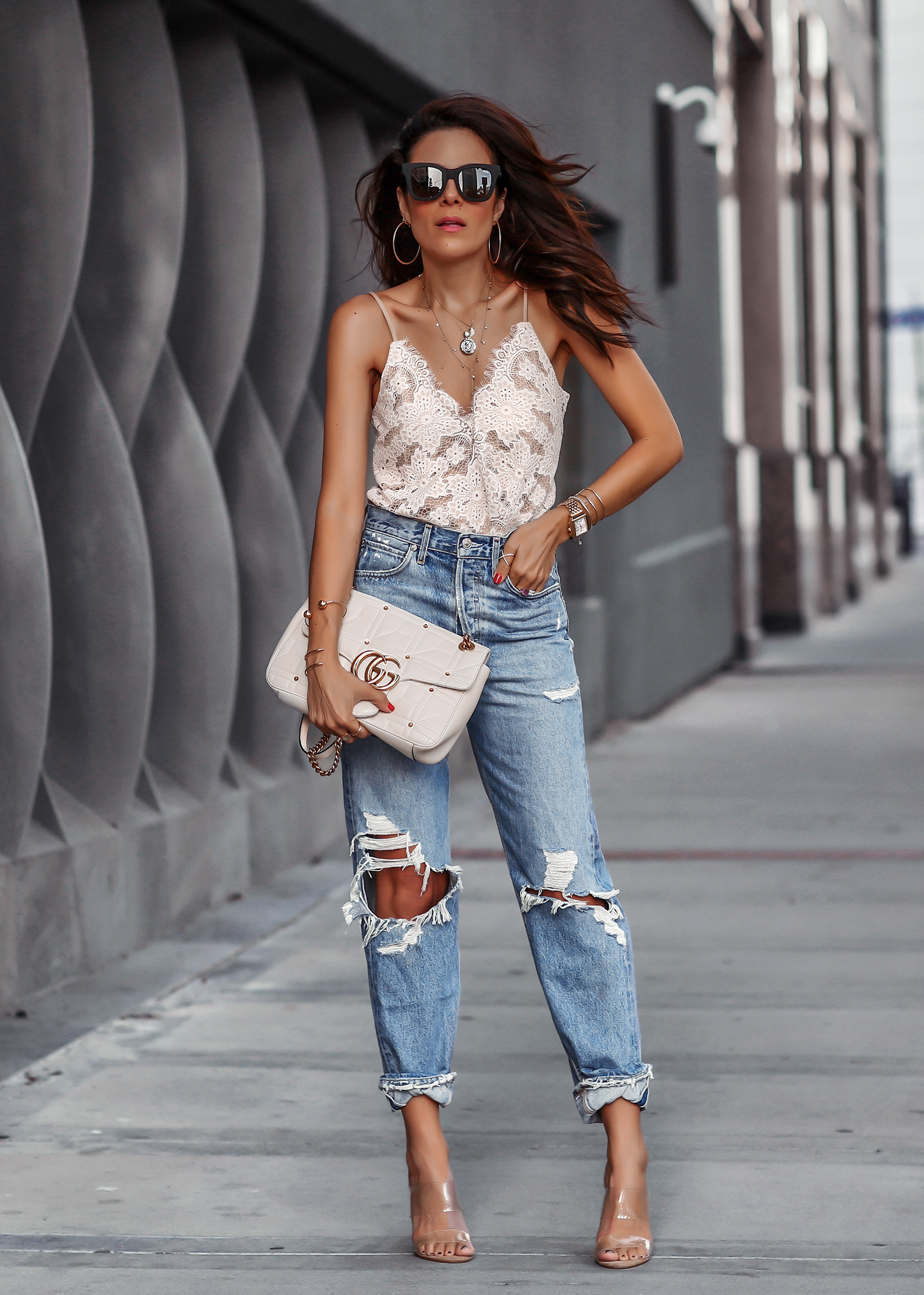 Brunette Woman in Ripped jeans White Gucci Marmont Bag