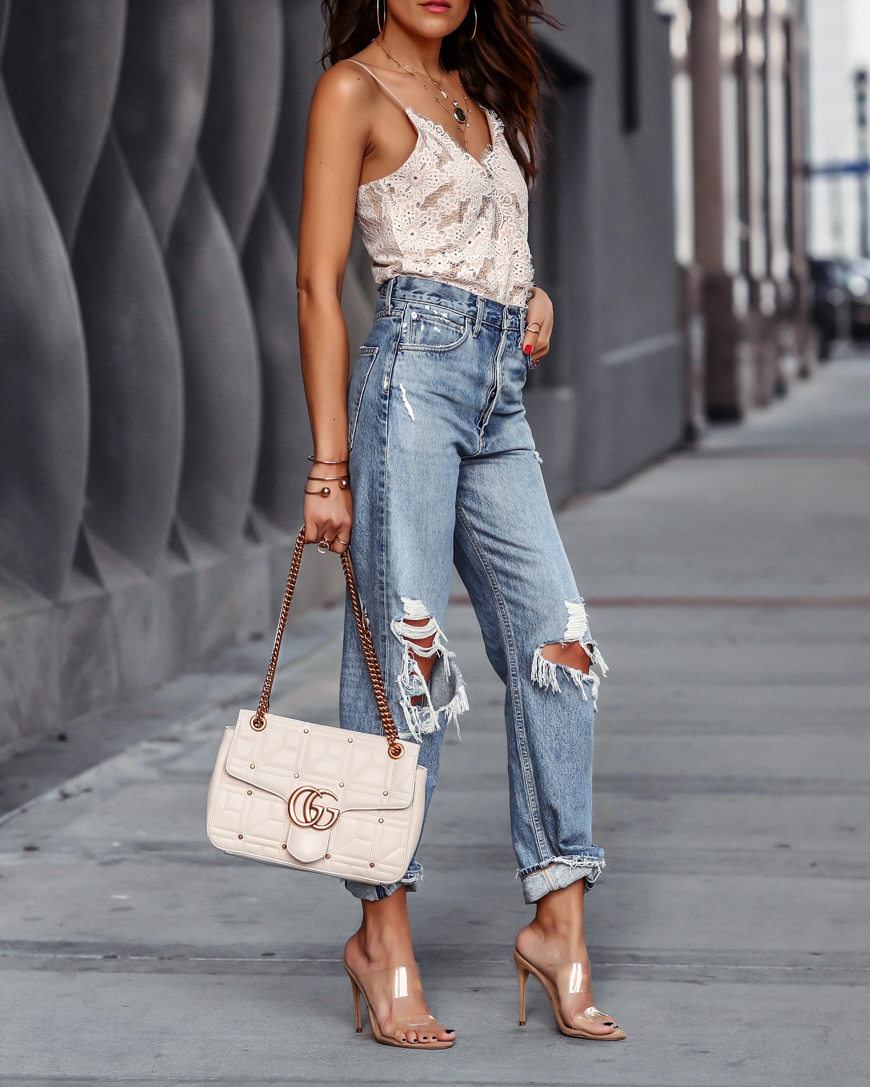 Woman in Steve Madden Clear Mules Ripped jeans White Gucci Marmont Bag