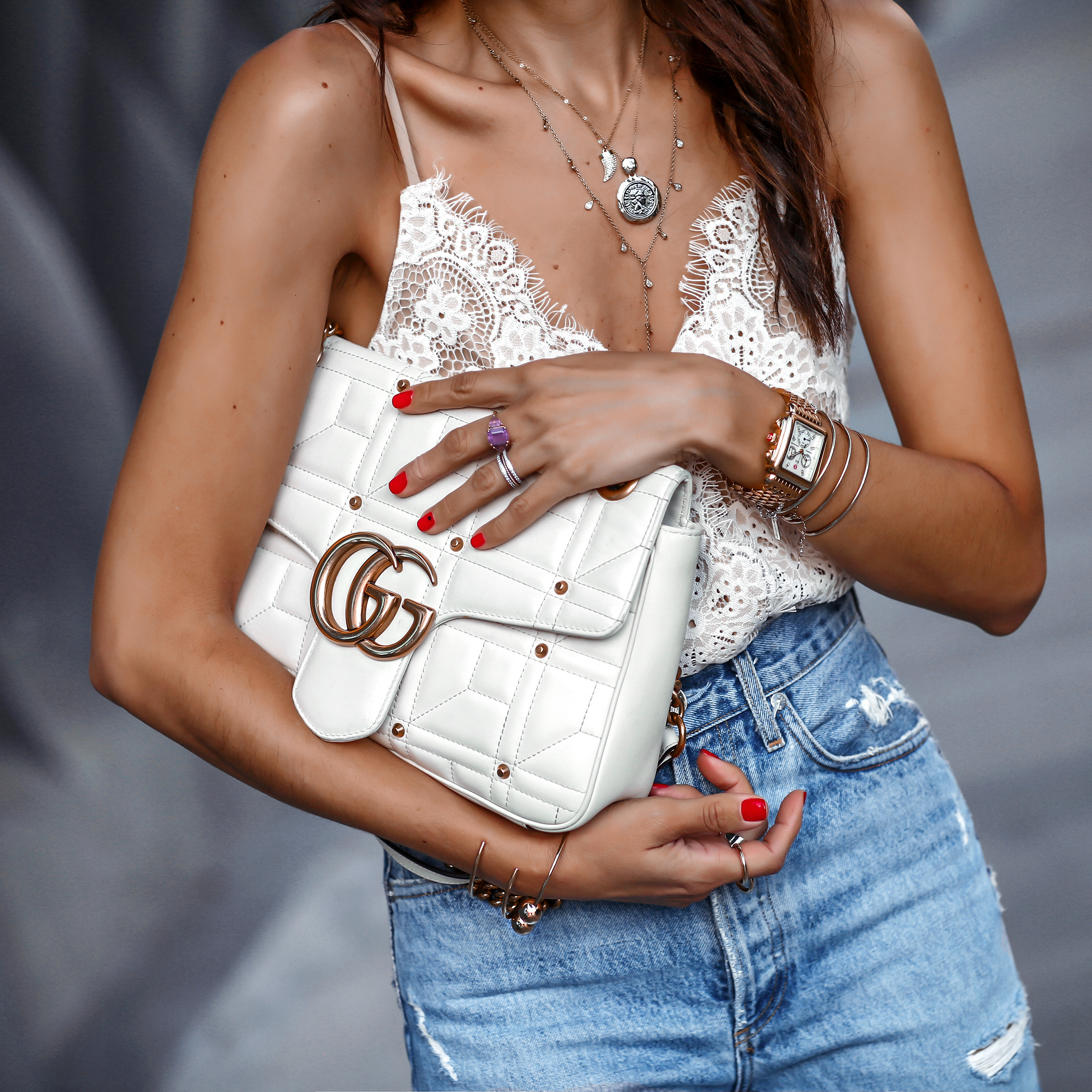 Detail Shot Of Brunette Woman in Lace Top White Gucci Marmont Bag