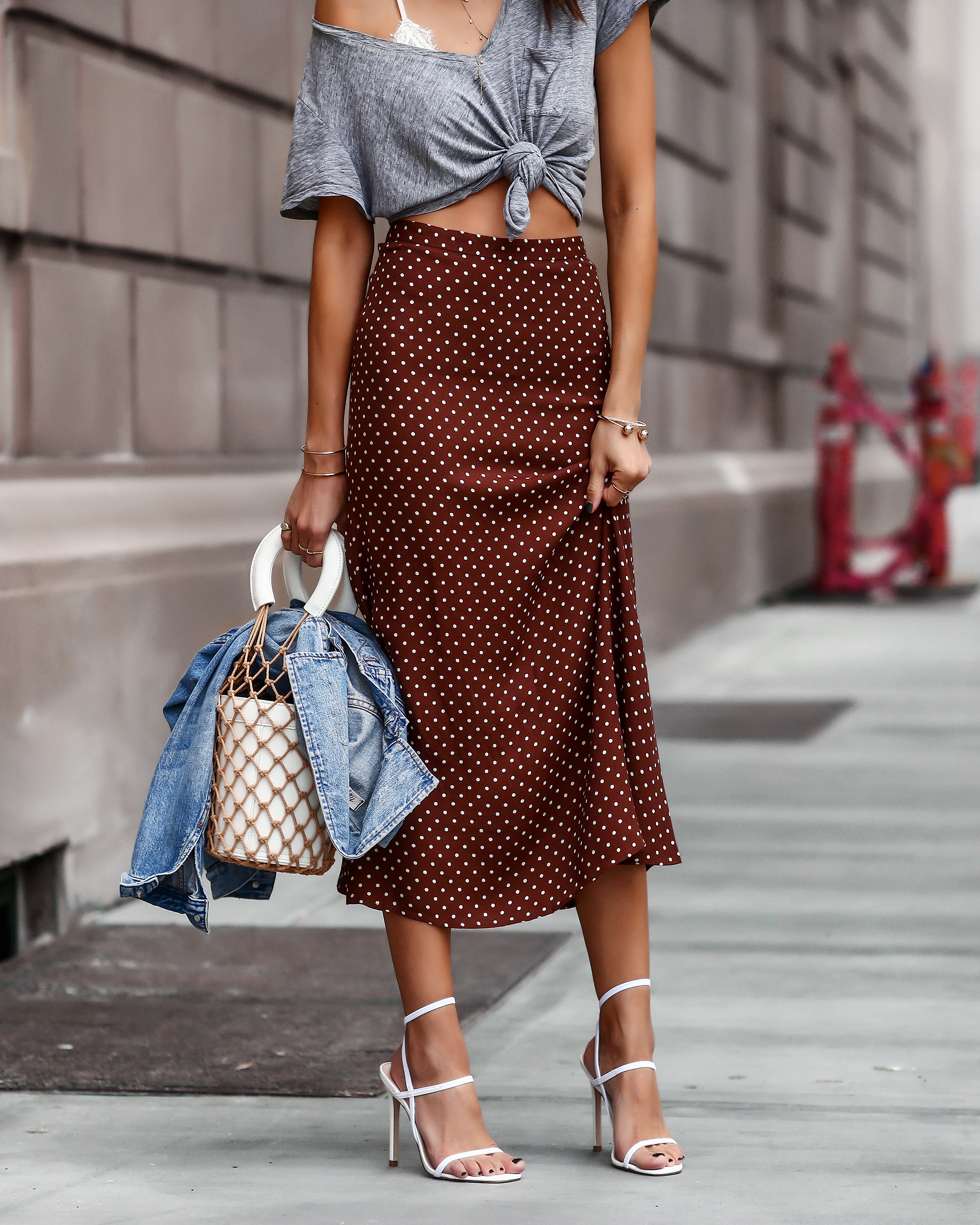 Woman in Nordstrom Summer Fashion Reformation Skirt and Steve Madden White Sandals