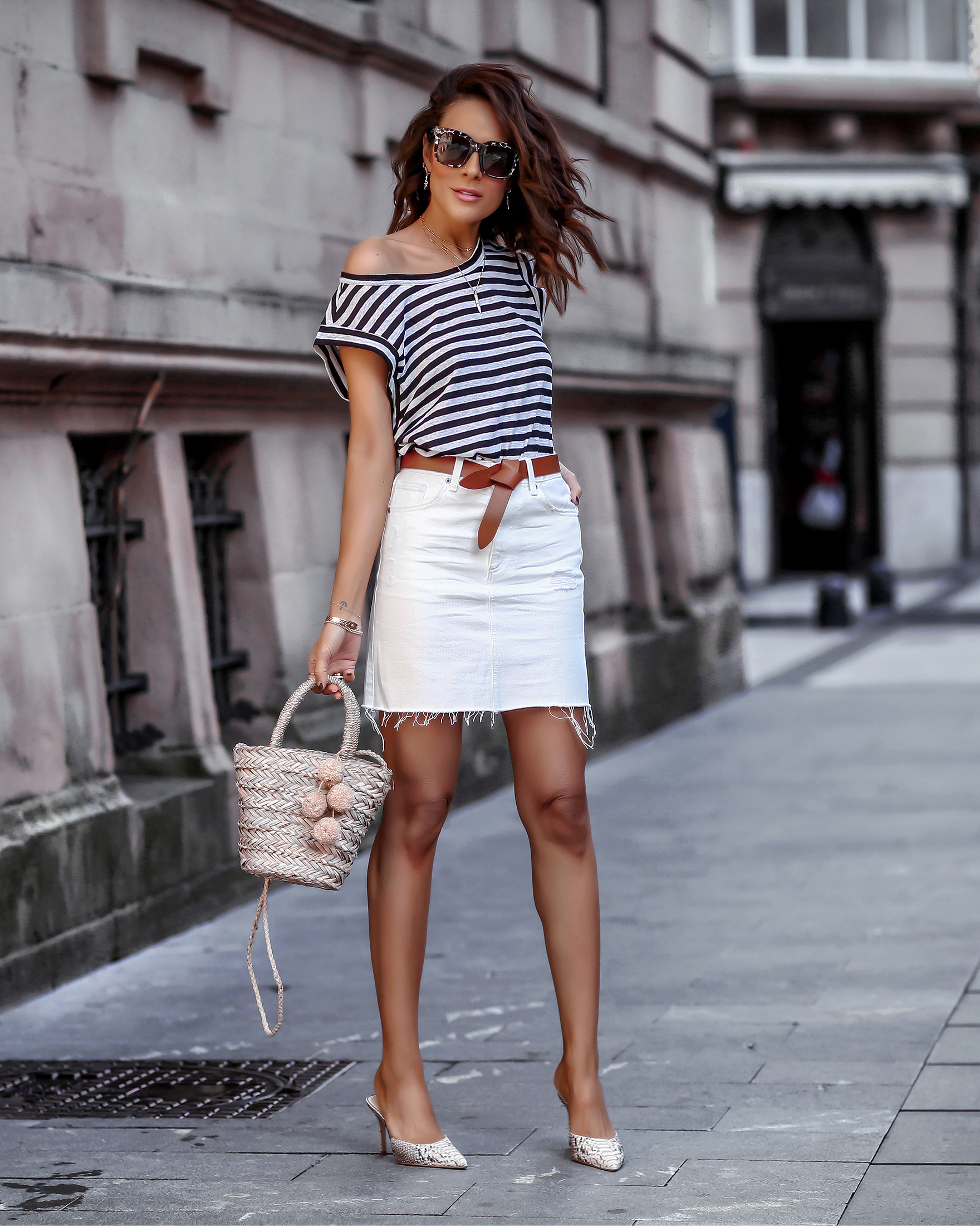 Brunette Woman in Striped Top in Summer Resort Style.