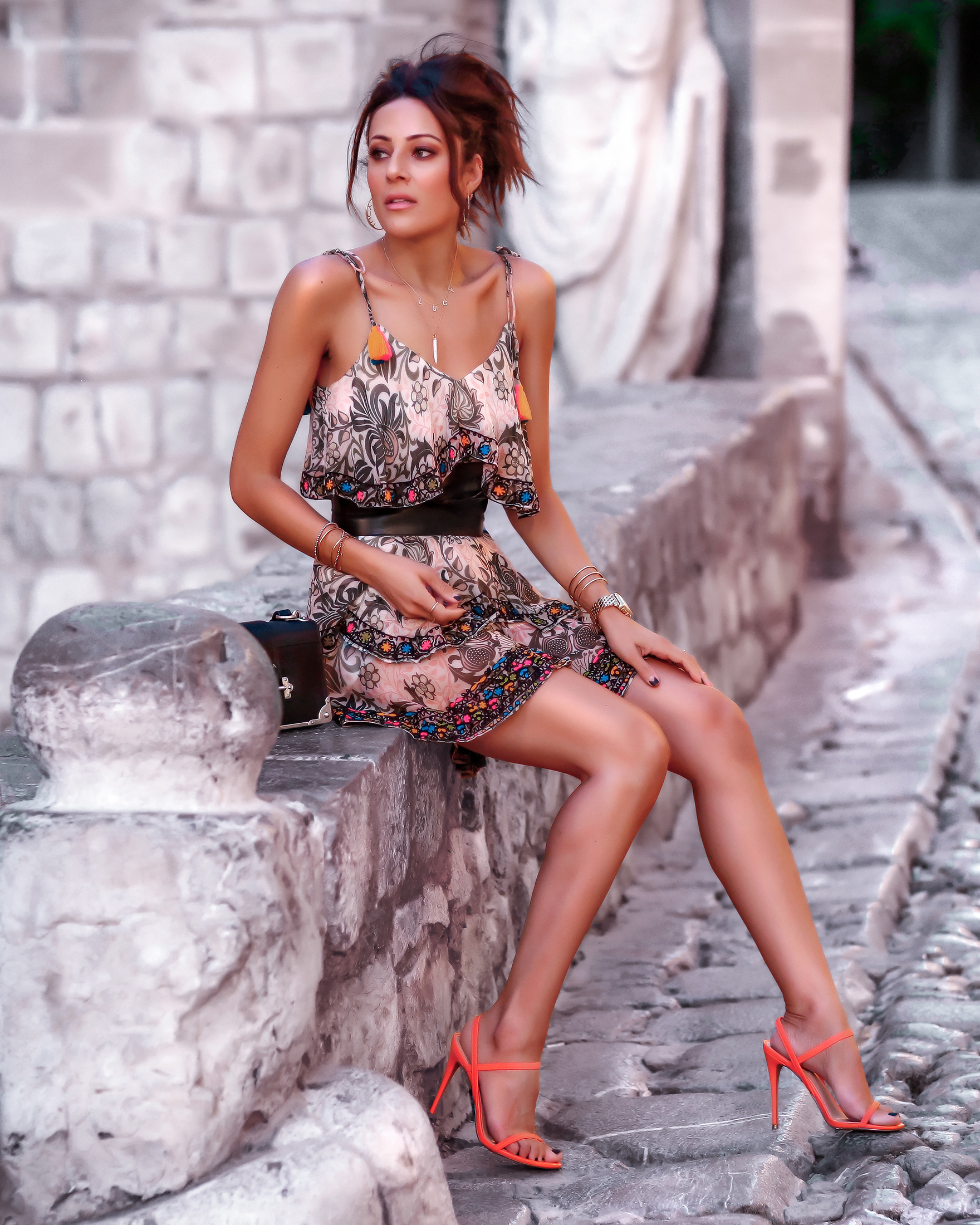 Brunette Woman in Ibiza in Summer Dress and Steve Madden Neon Sandals
