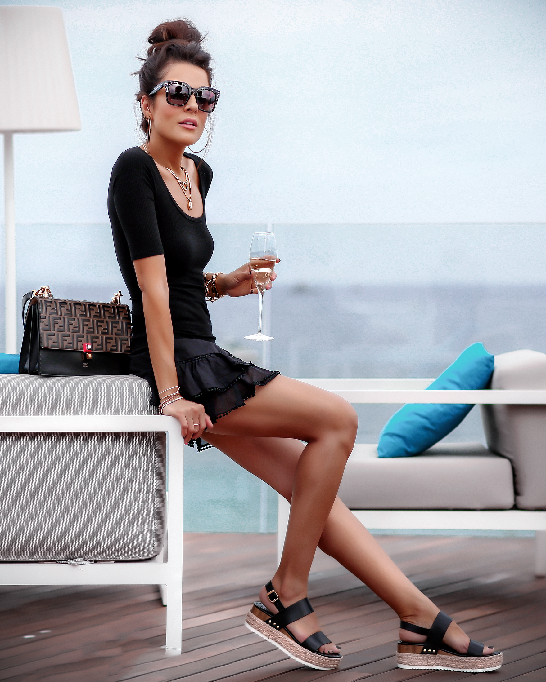 Brunette Woman in All Black and Steve Madden Sandals