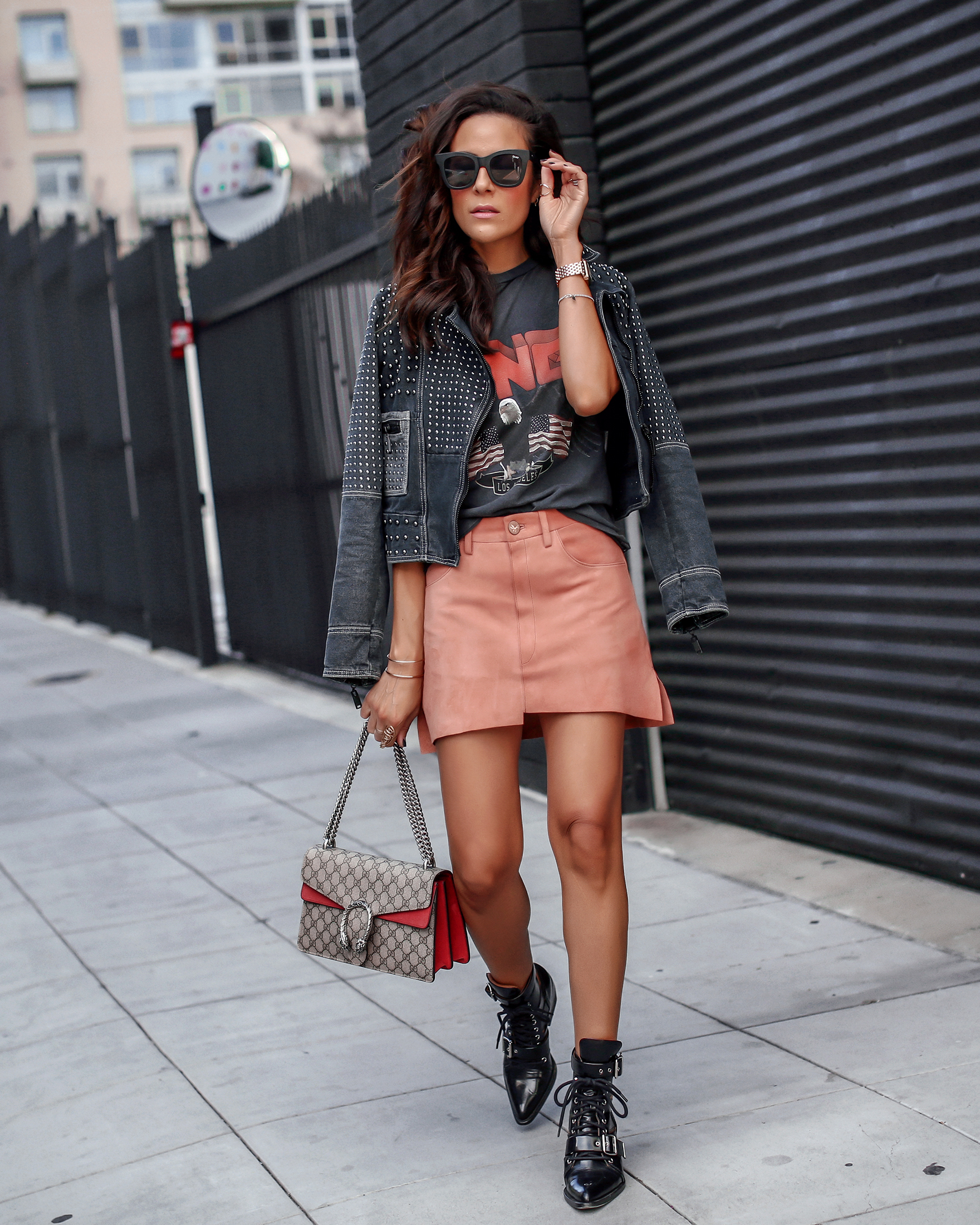 Woman in Peach Suede Skirt Graphic Tee Chloe Boots