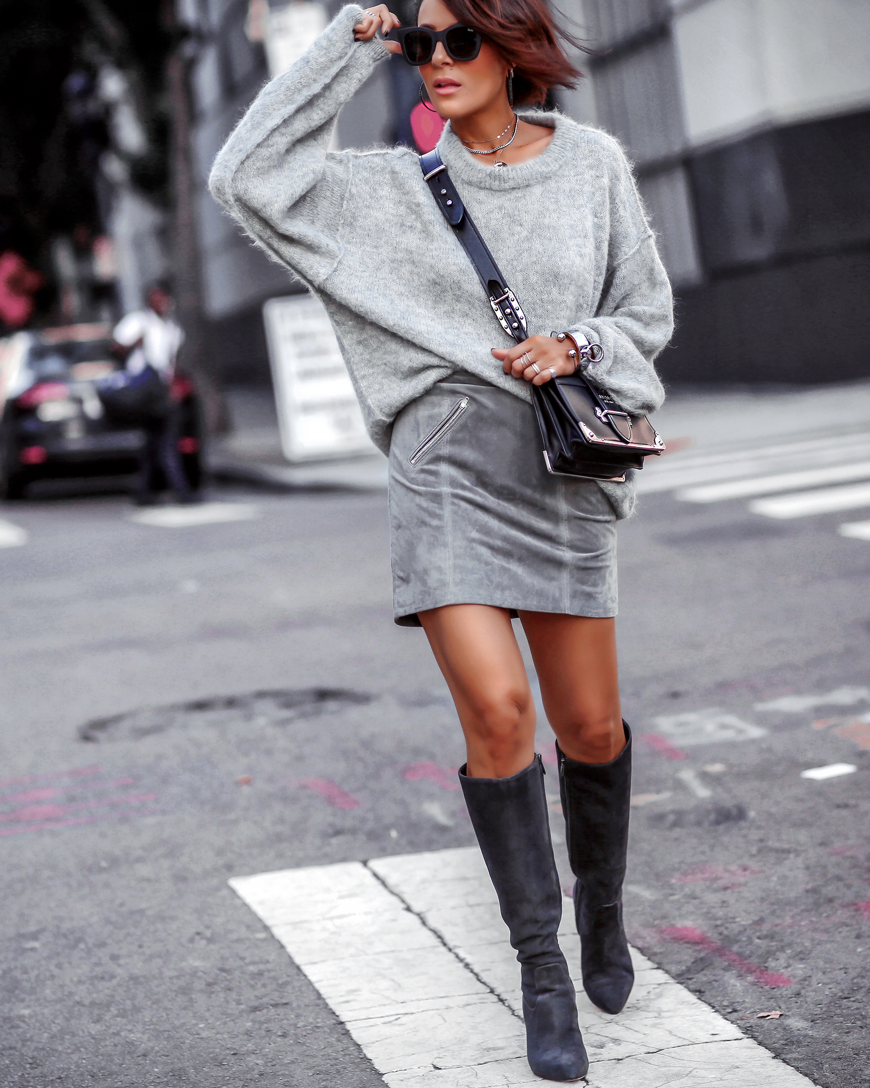 Brunette Woman in All Grey Monochrome Fall Fashion Knee High Boots