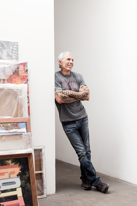 Cliff Benjamin at gallery with artwork, photo by Joe Schmelzer