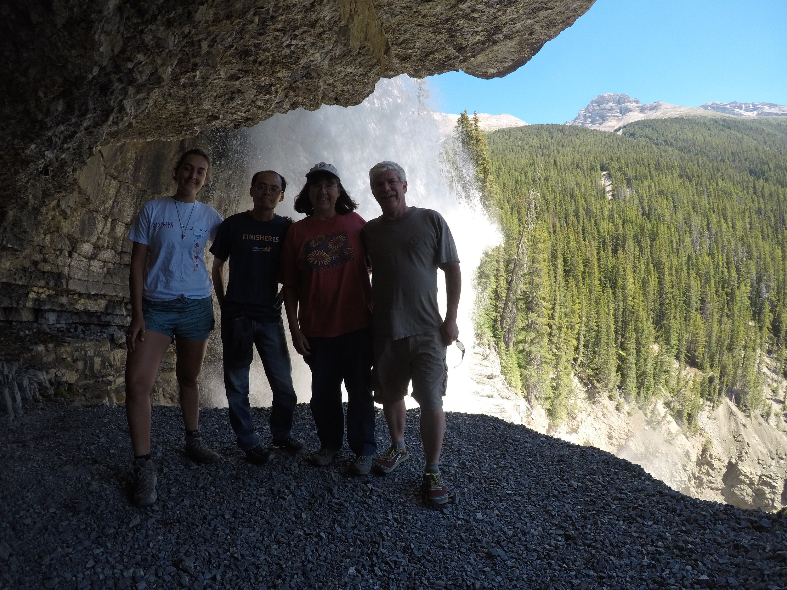 Waterfall adventure during a guided tour of the rocky mountains.