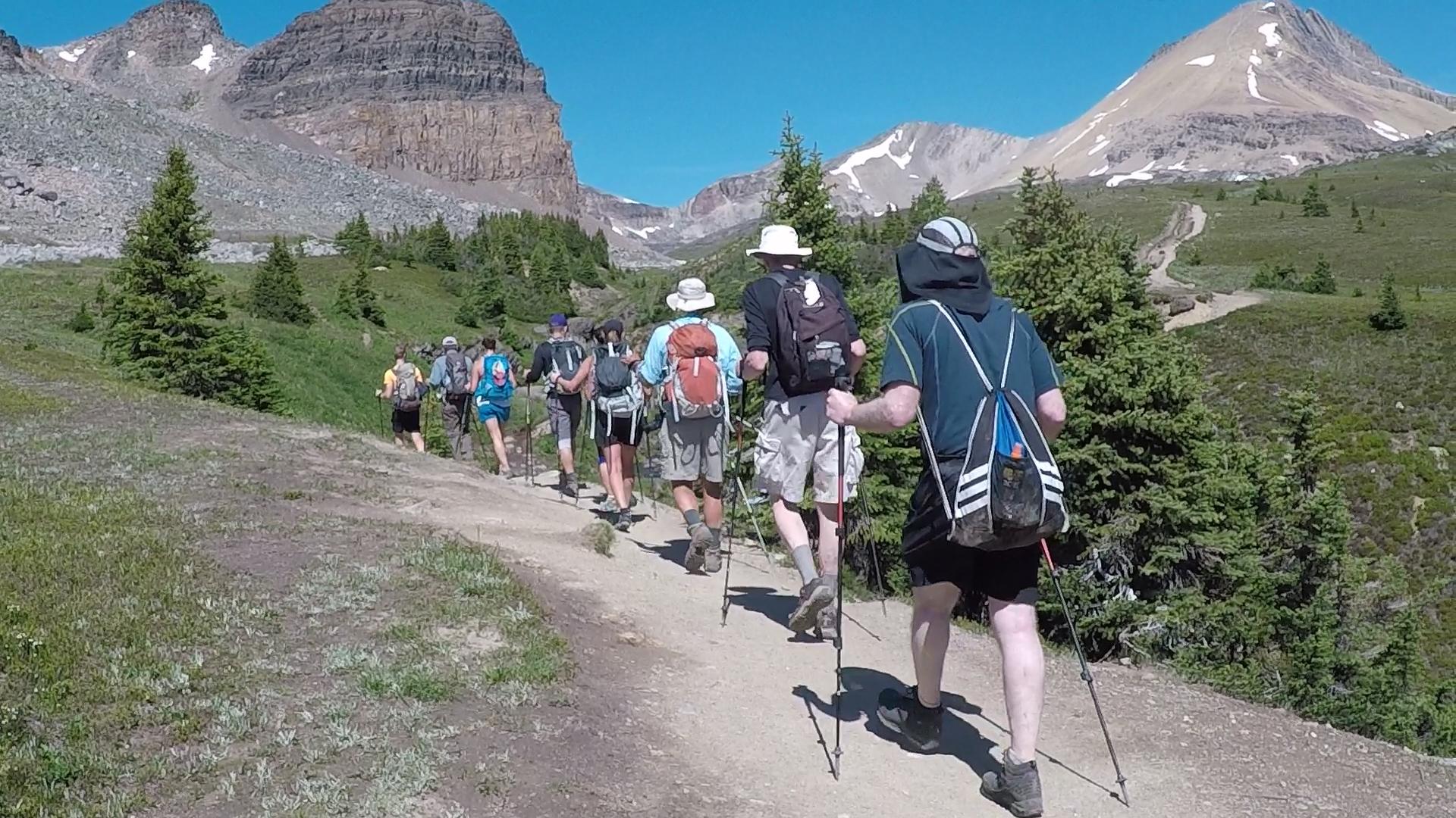 Active travelers enjoy hiking tour near Lake Louise.