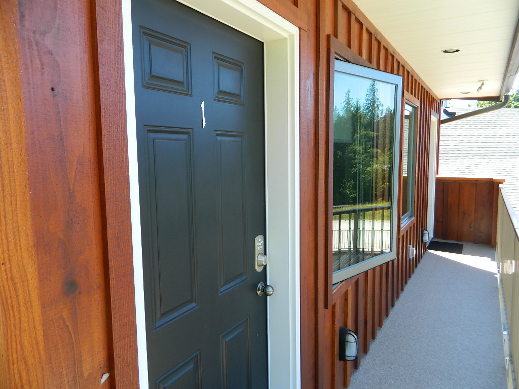Shown here is the entrance for Suite #1. At the end of this walkway shown in this photo is the entrance for Suite #2.
