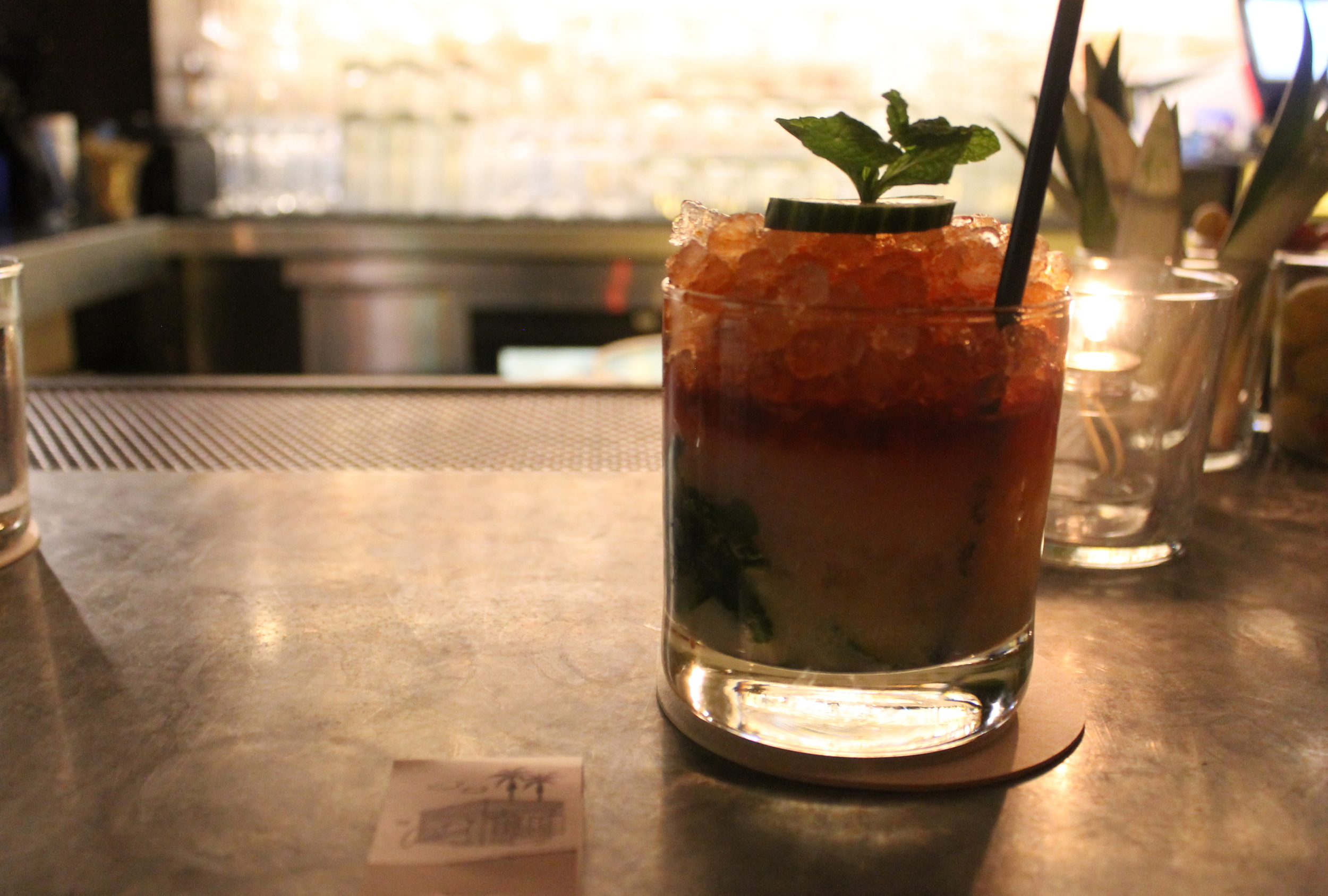The Westside: Vodka, Orgeat, Lime, Cucumber, Mint, and Bitters.