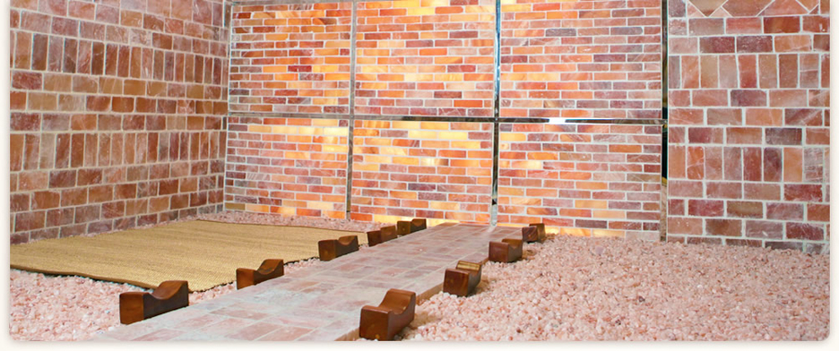 In the Salt Sauna, guests lay down and relax in hot, pink salt crystals