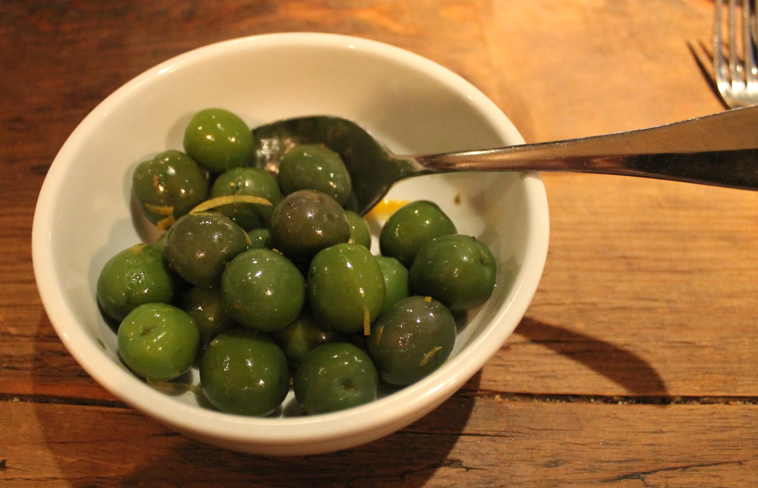 Marinated olives with chilies, parsley, and orange
