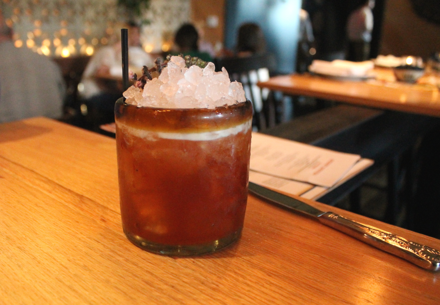 The Surfer Rosa: Pimms No. 1, Ancho Reyes, Lemon, Strawberry Shrub, Basil Flower.