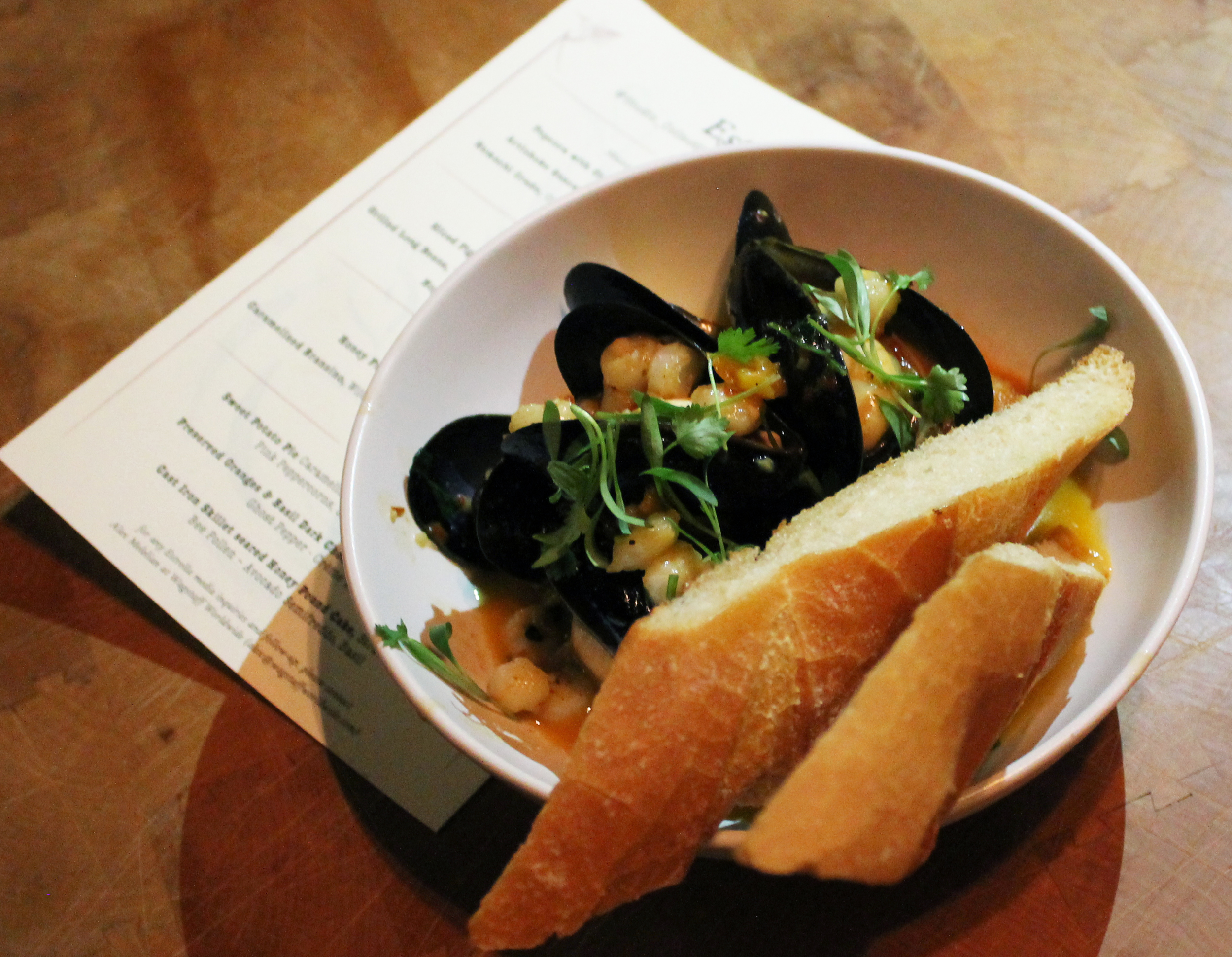 Mussels: harissa, red ale, hominy