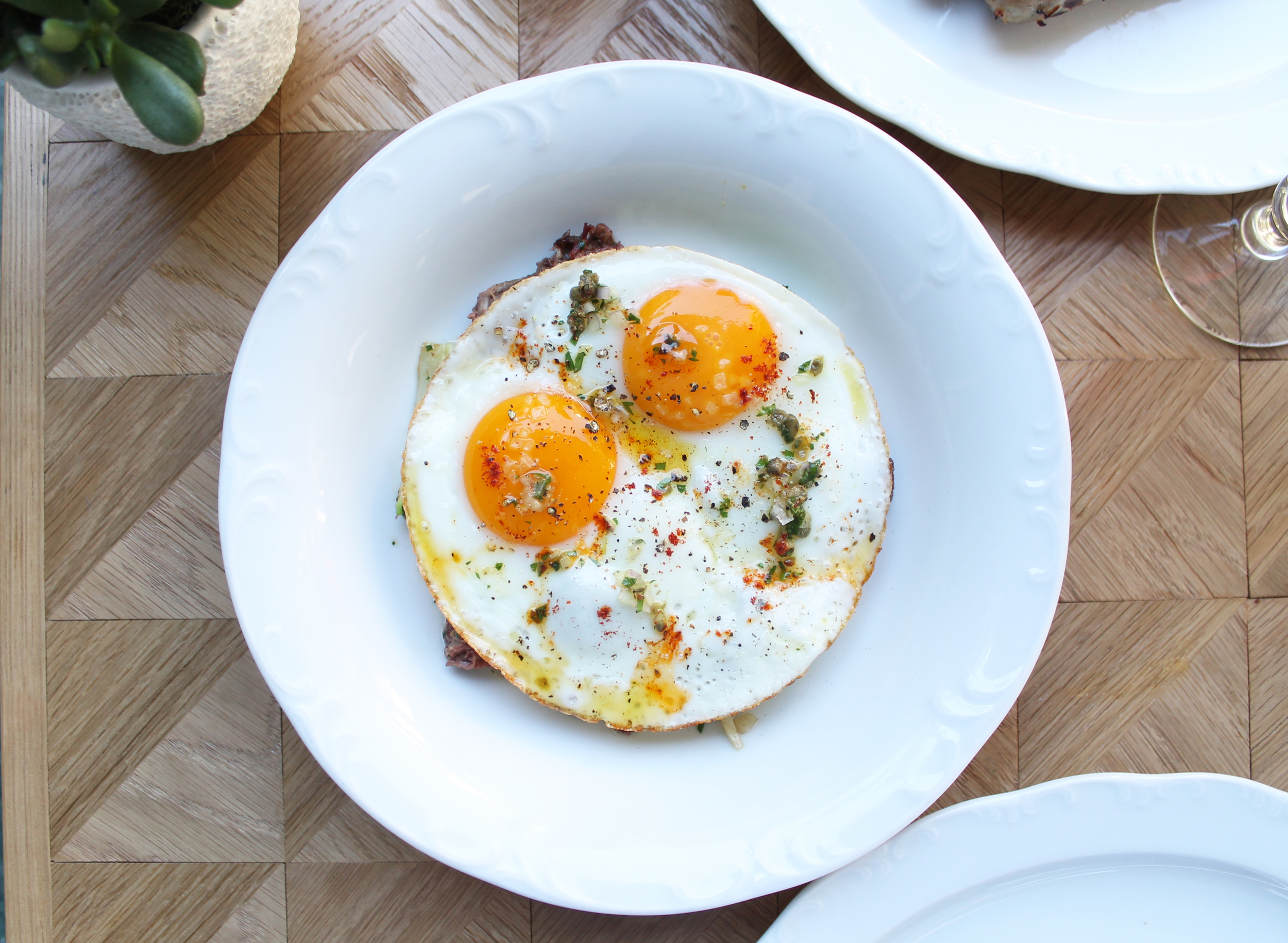 SUNNY SIDE UP EGGS :Corned Beef and Cherry Tomato Hash, Caper Salsa Verde