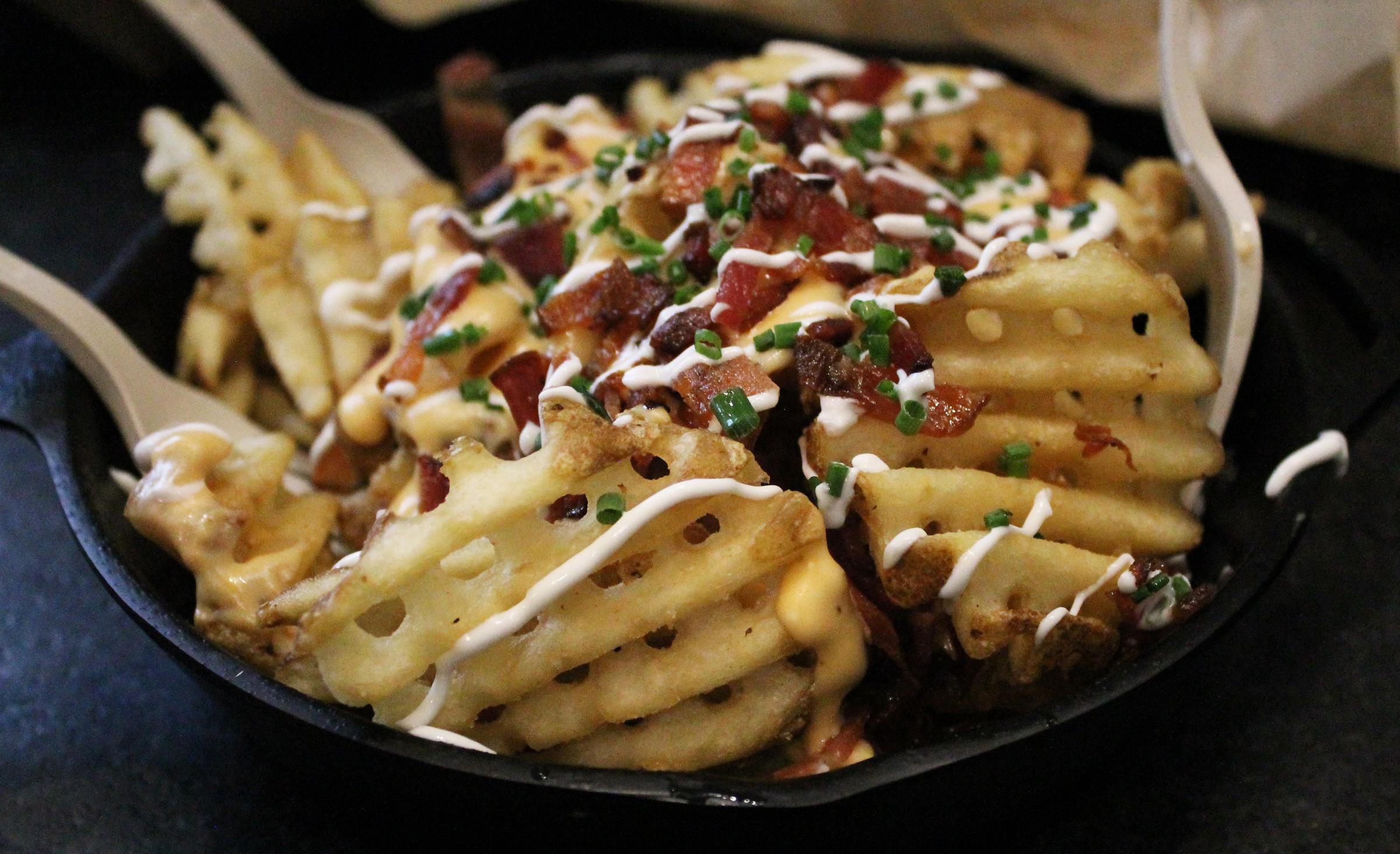IRISH NACHOS:Waffle Cut Fries, Bruxie Cheese Sauce, Applewood Bacon, Sour Cream, Chives