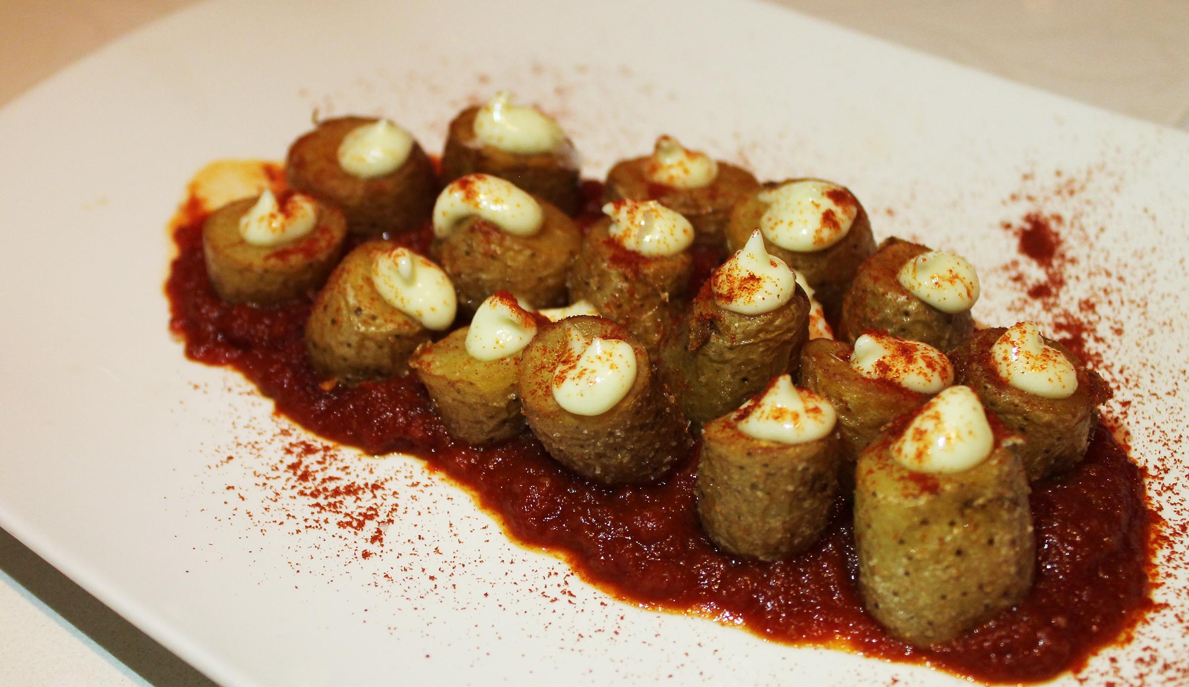 Patatas Bravas: A Jaleo favorite with spicy tomato sauce and alioli