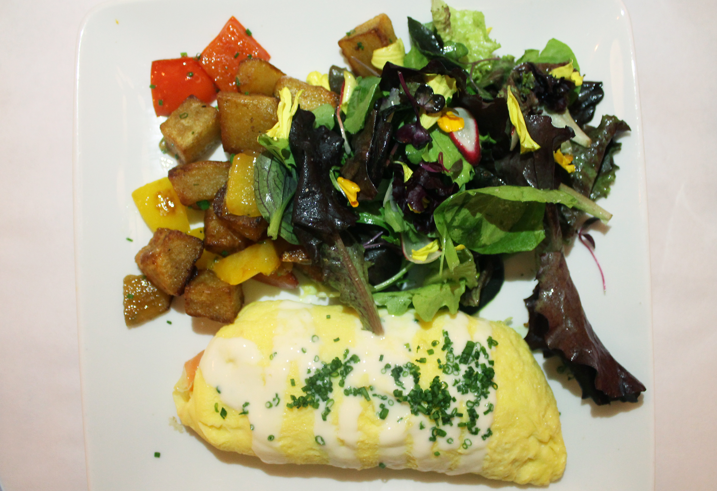 OMELETTE FLORENTINE: Smoked Salmon, Parmesan and Spinach Omelette,Crispy Potatoes, Mesclun Salad