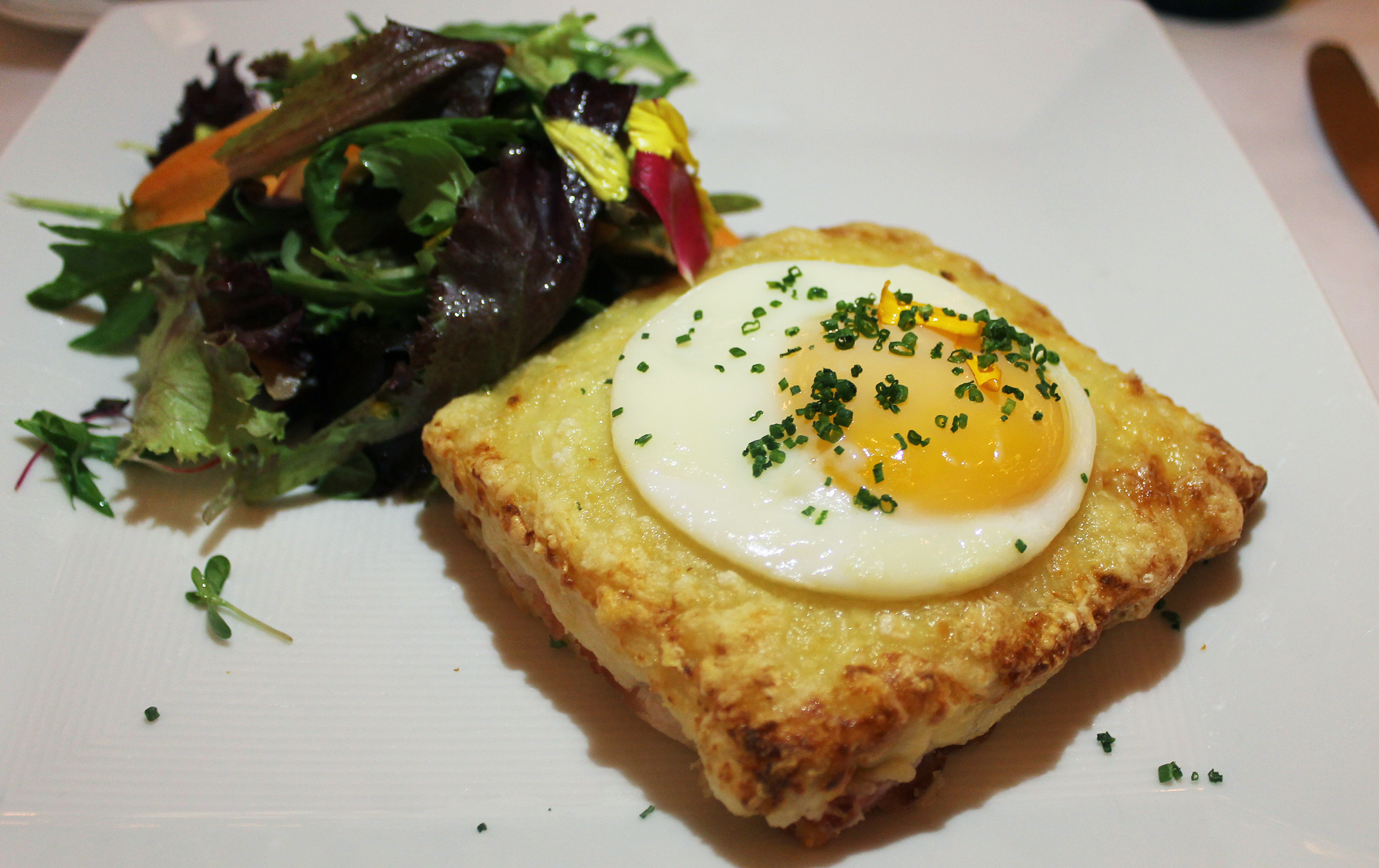 CROQUE MADAME:Gruyère Cheese and Béchamel,Warm Ham, Sunny Side Up Farm Egg
