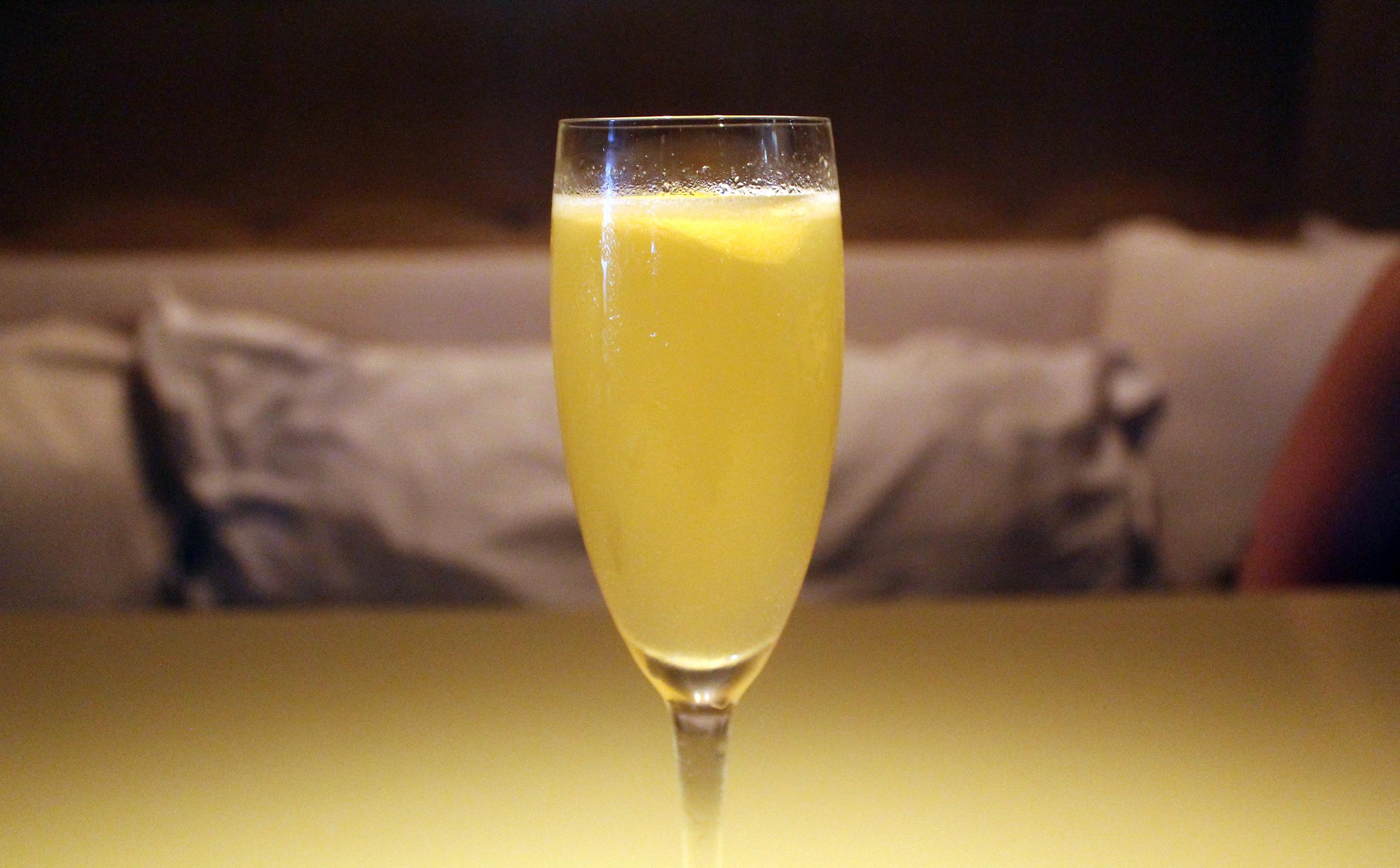 The Backspin:bombay sapphire, prickly pear, honey syrup, lemon juice