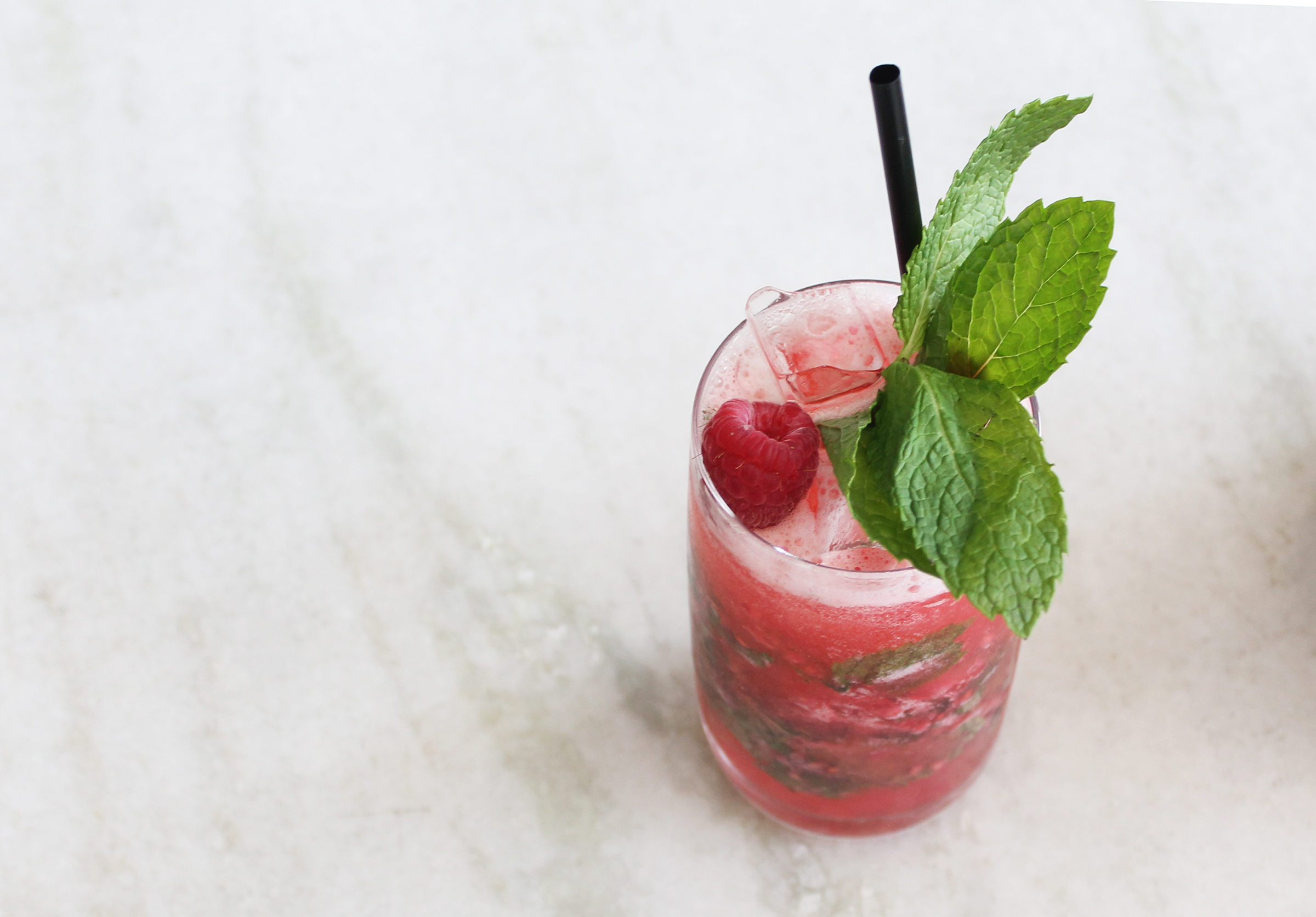 RASPBERRY MOJITO: Rum, muddled raspberry, fresh mint & lime juice topped with club soda
