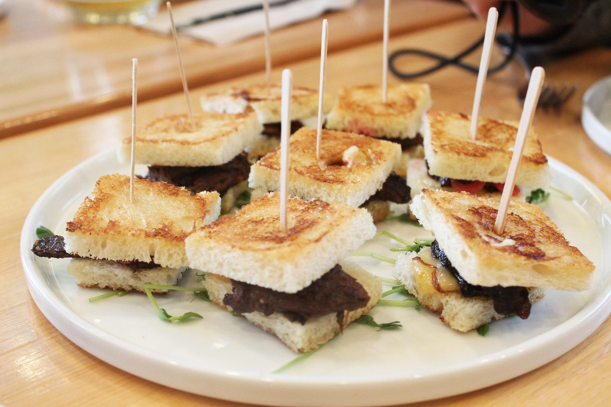 Briana's Short Rib Grilled Cheese :  Stout Braised Onions, Roasted Mushrooms, 'Merican Cheese, Black Vinegar Teriyaki, and russet wedges
