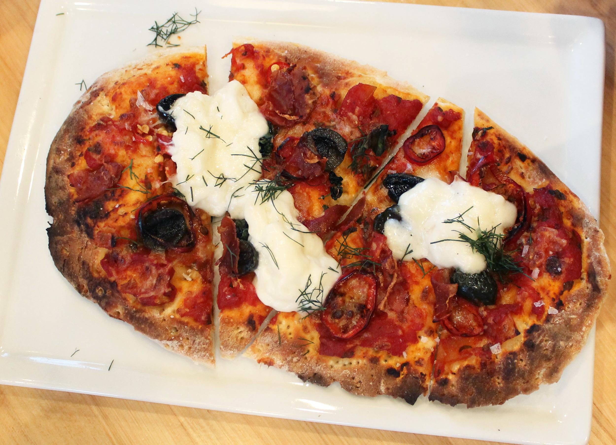 Serrano Ham and Olive Naan-Zza:fresno chile, burette cheese, oregano