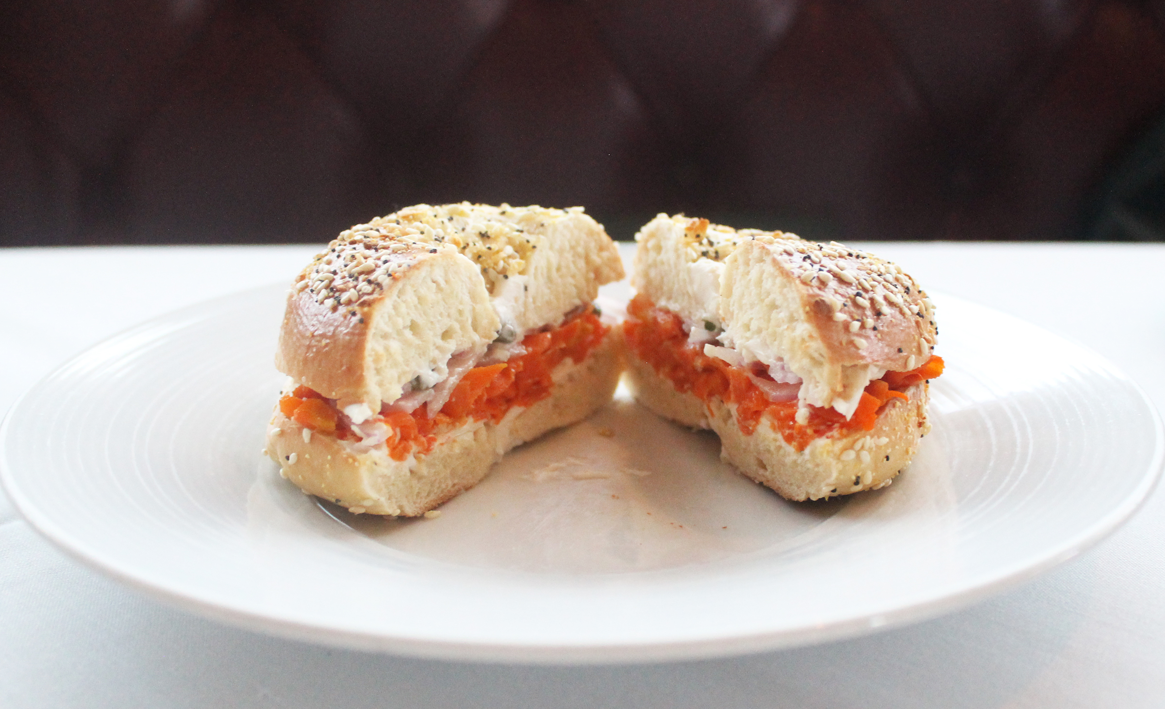 Jann's Bagel: everything bagel / almond cream cheese / smoked heirloom carrot lox / shaved red onions / capers