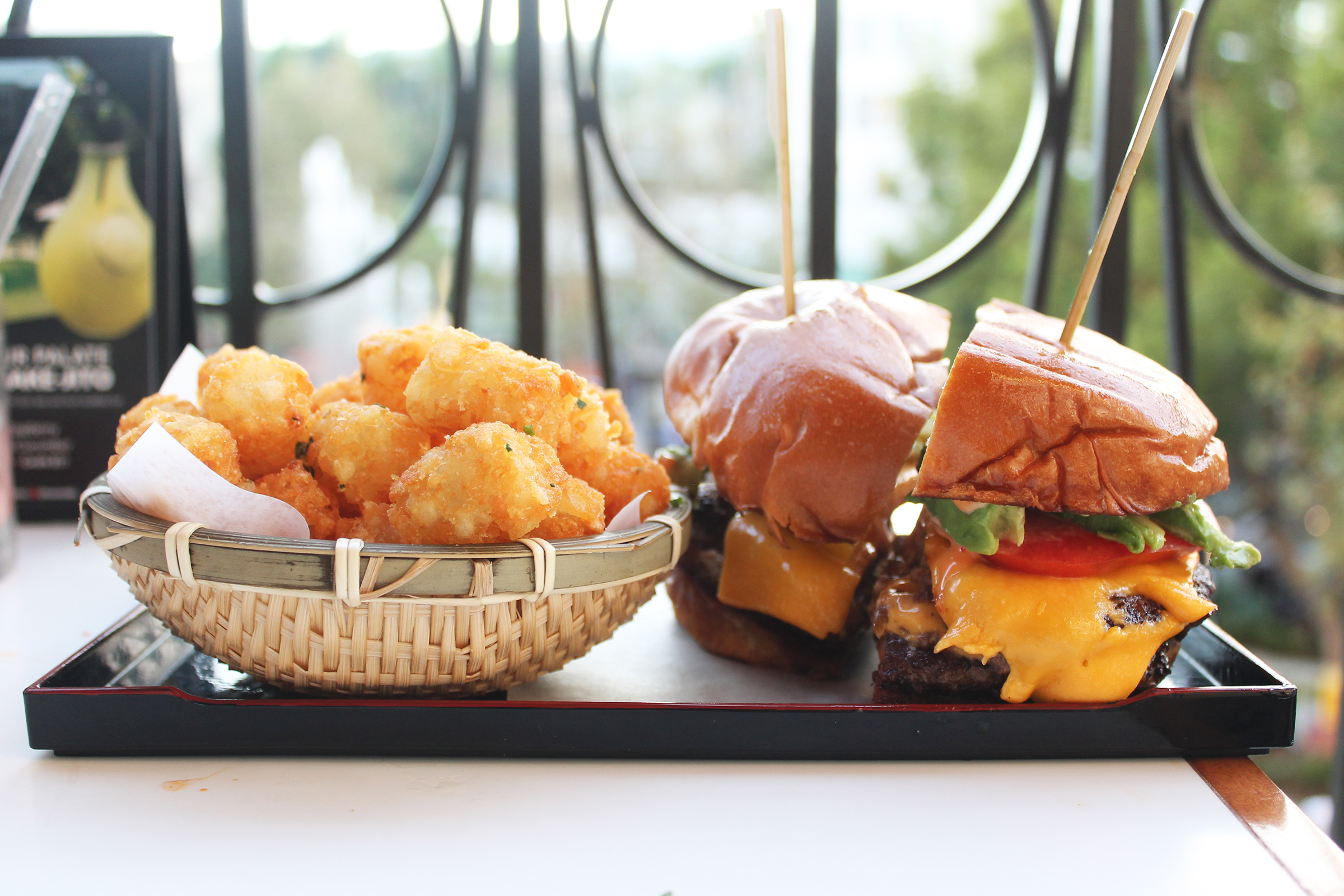 Burger:  1/2 pound with Chef's Spicy Creamy Sauce, Caramelized Onion, Tomato, American Cheese, and Tots
