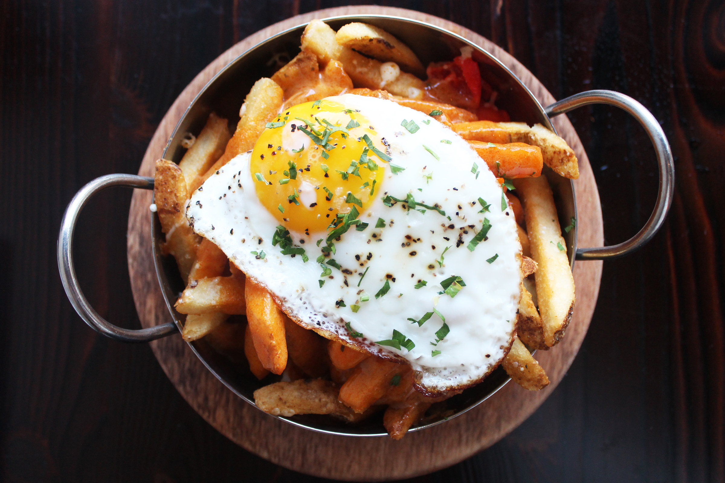 """""""Benedict"""" Fries: Fries, Pit Smoked Ham, Peppers, Raclette Cheese, Smoked Paprika Hollandaise, Sunny Side Up Egg"""