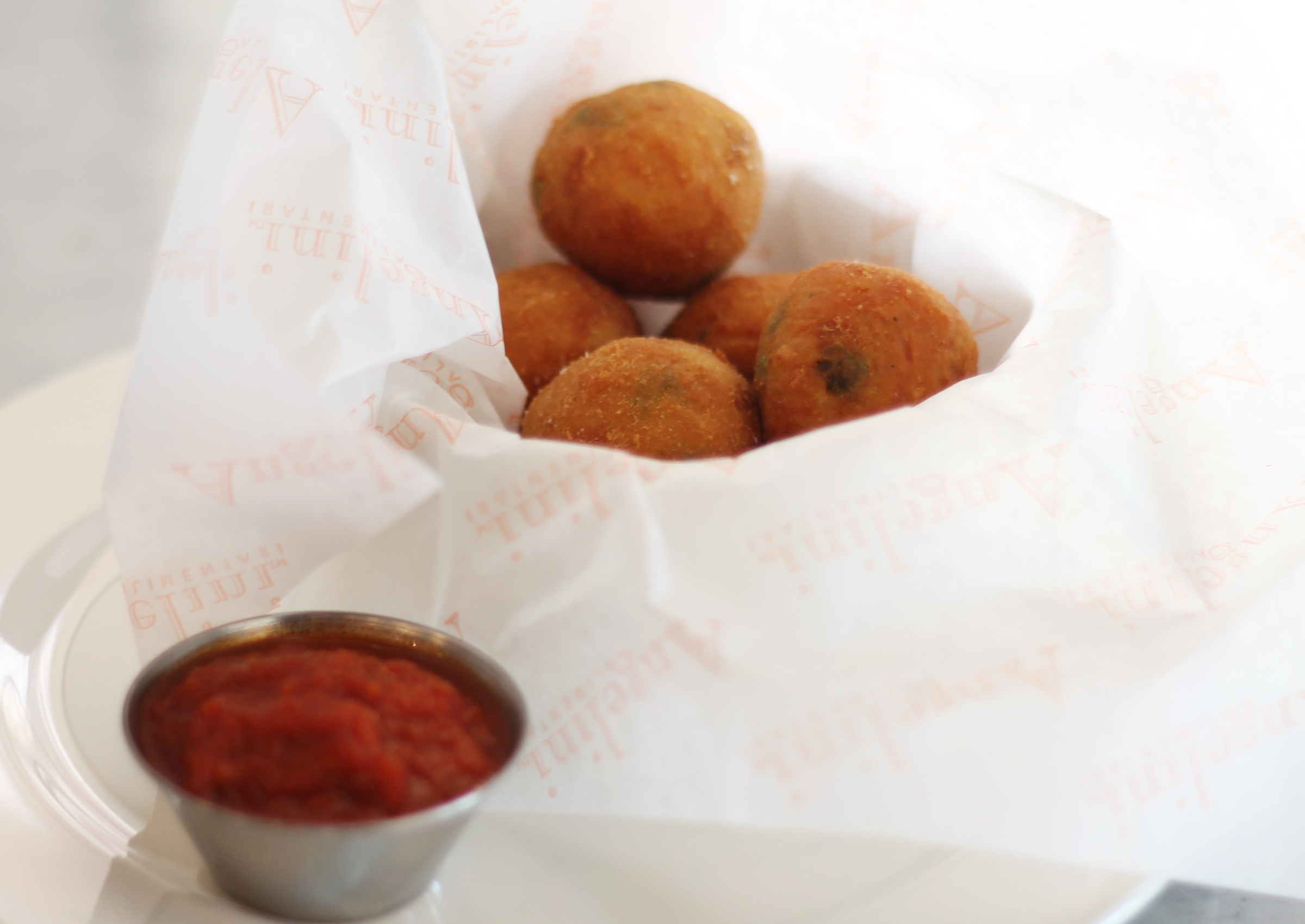 Arancini:fried rice balls, peas, tomato sauce