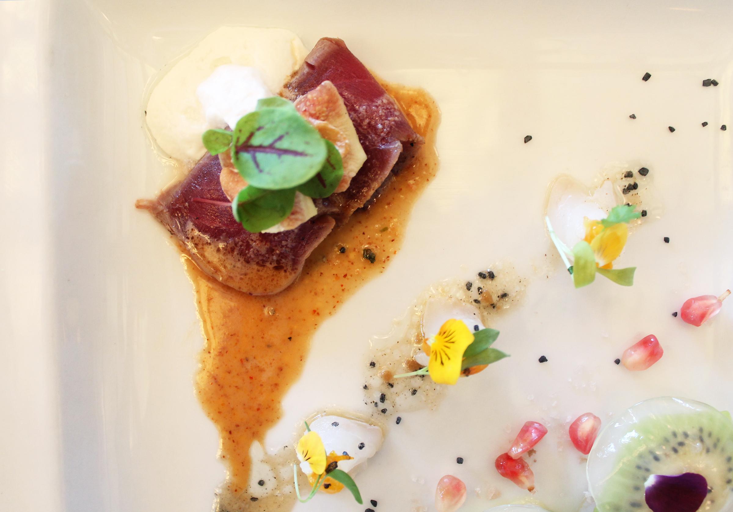 Seared Bluefin Tuna with Almond Sauce and Goat Cheese Foam, Fig Garlic Chip. Fluke Kumquat with Yuzu Dressing, Kumquat Jam, Cilantro, and Black Lava Salt
