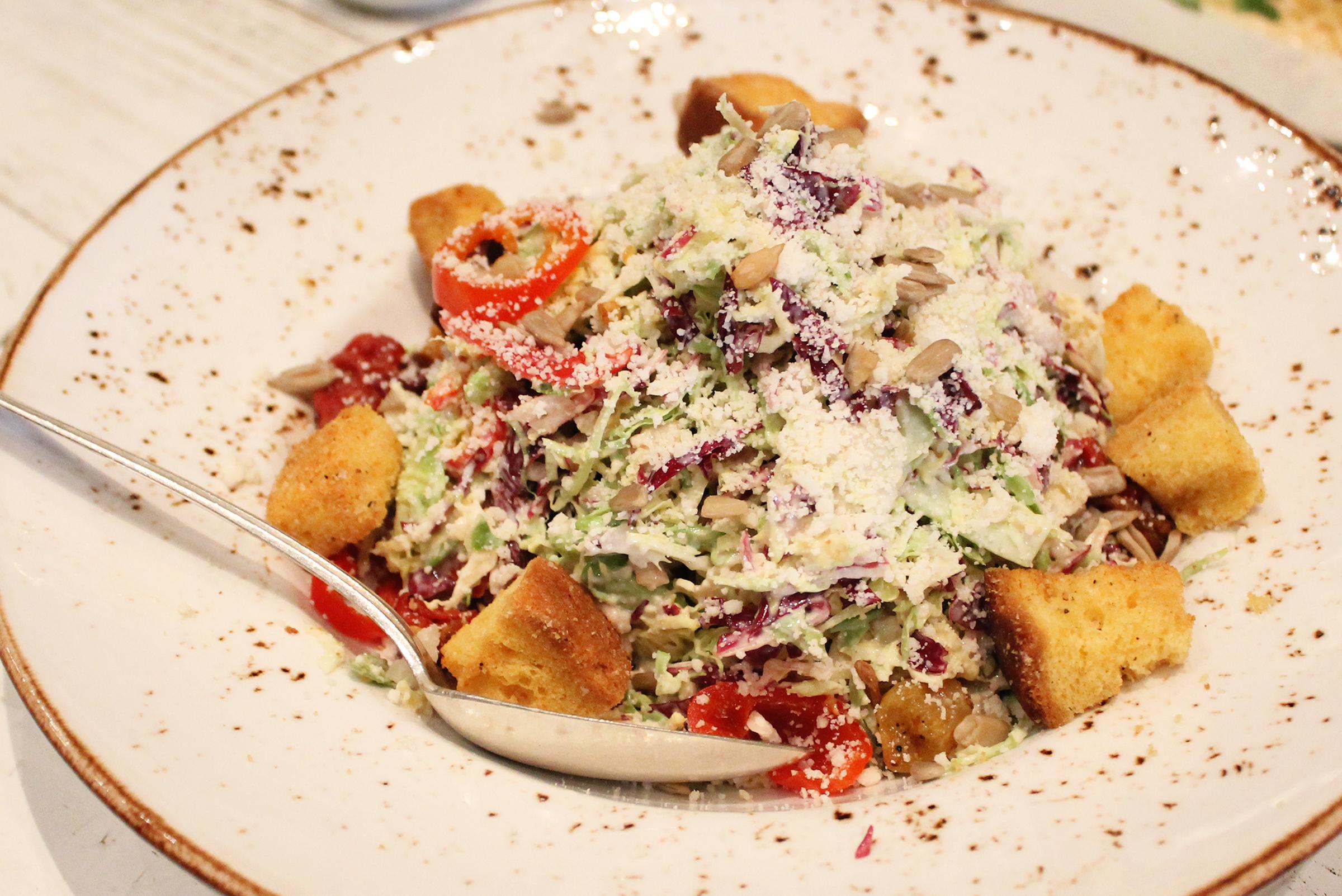 "BRUSSELS SPROUT ""CAESAR SALAD"": Tomato Raisins / Sunflower Seeds / Brioche Croutons / Parmesan Cheese"