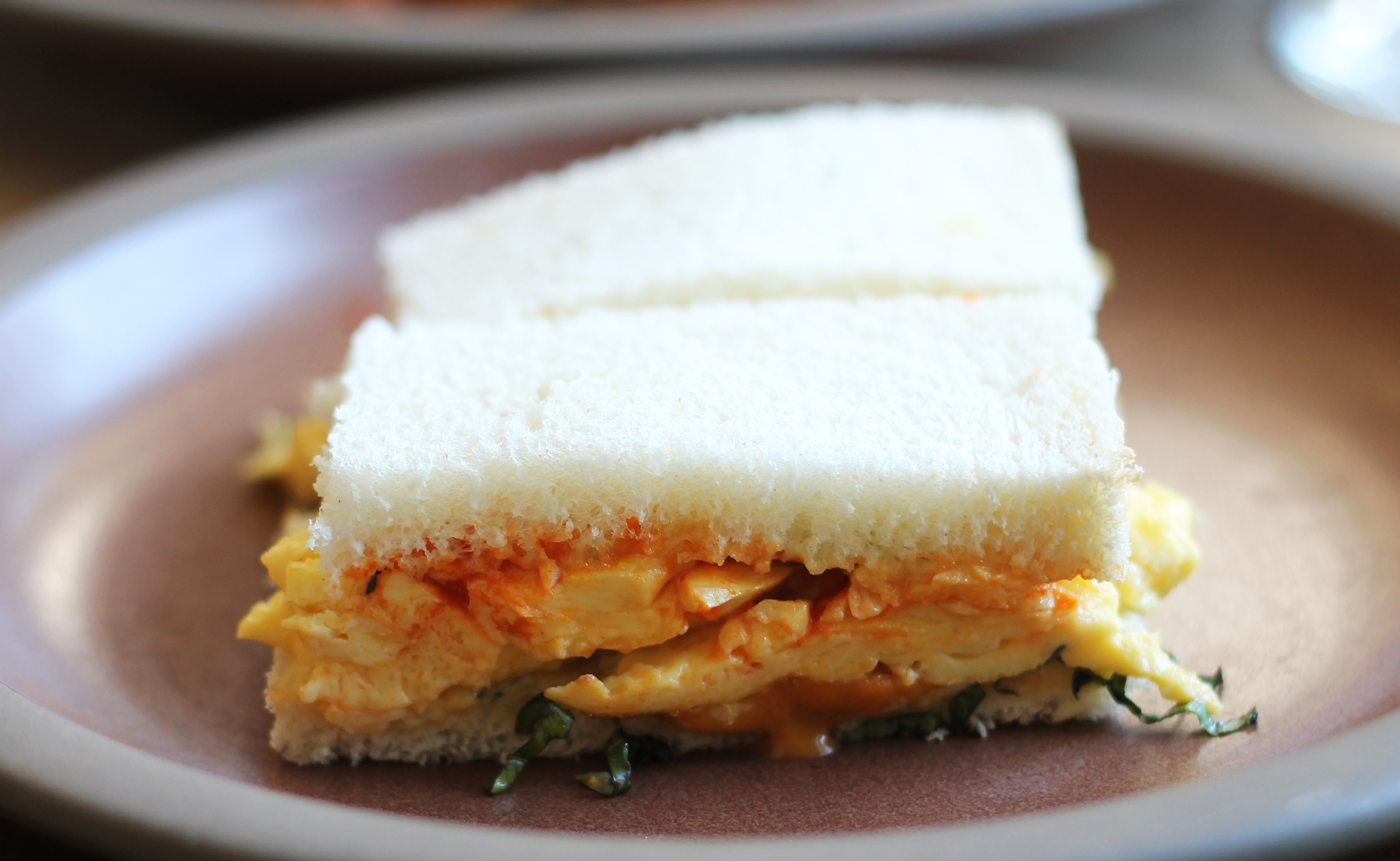 Scrambled egg and sea urchin panini, basil, chilies